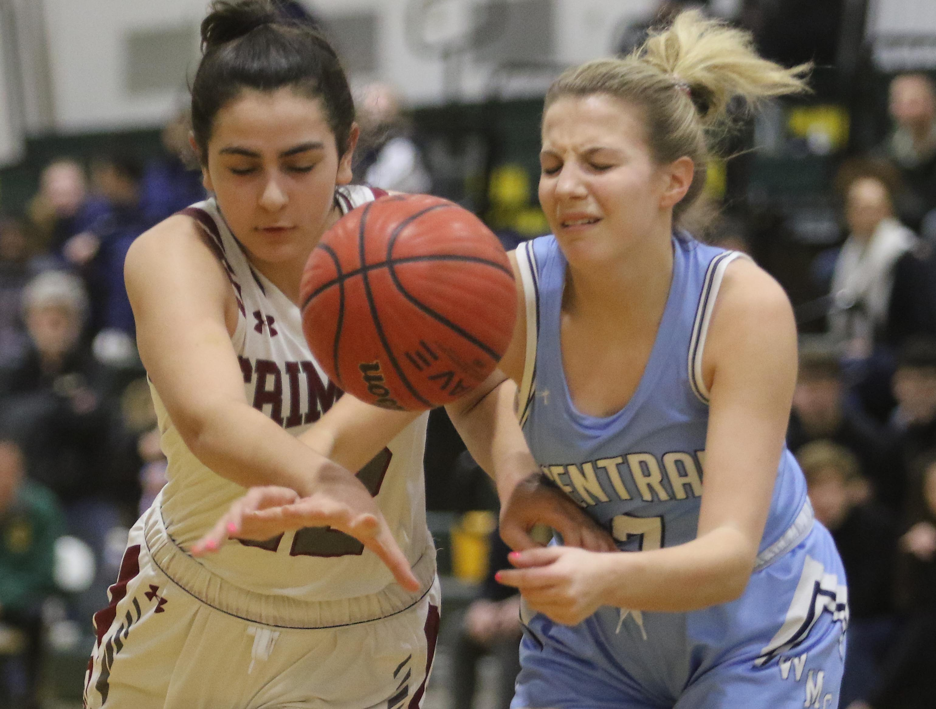 Morristown-Beard junior Addisyn Ibrahim goes for a rebound with Mackenzie Selvaggi of West Morris in the first half.