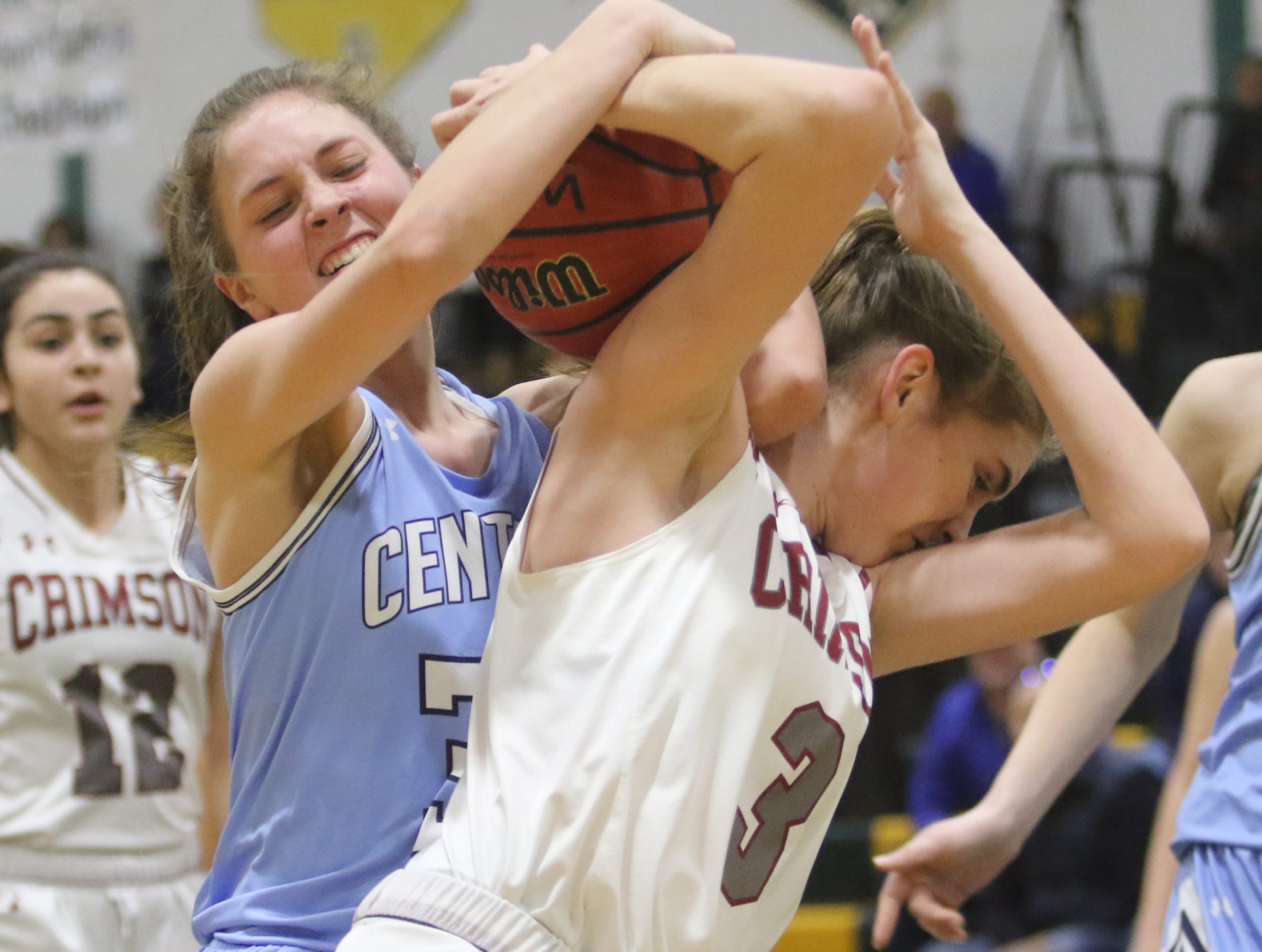 West Morris junior Elizabeth Mancini  fights for a rebound with 6-foot Morristown-Beard sophomore Erin Martin in the first half of a Morris County Tournament girls basketball quarterfinal.