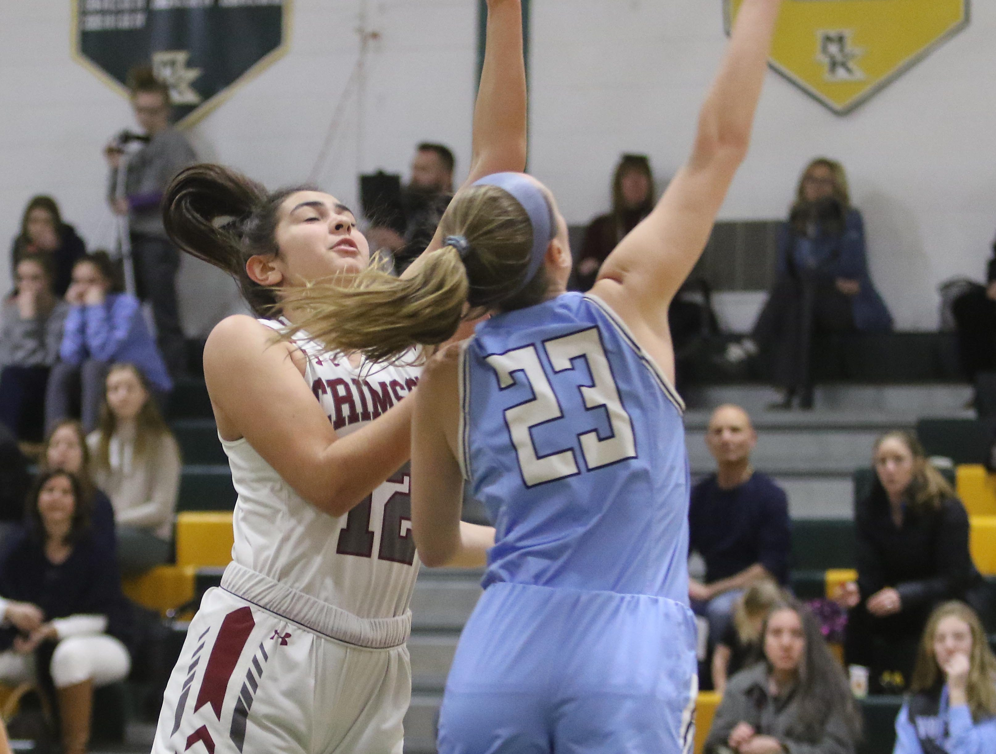 Faith Pappas of West Morris knocks the ball away from Addison Ibrahim of Morristown-Beard in the first half.