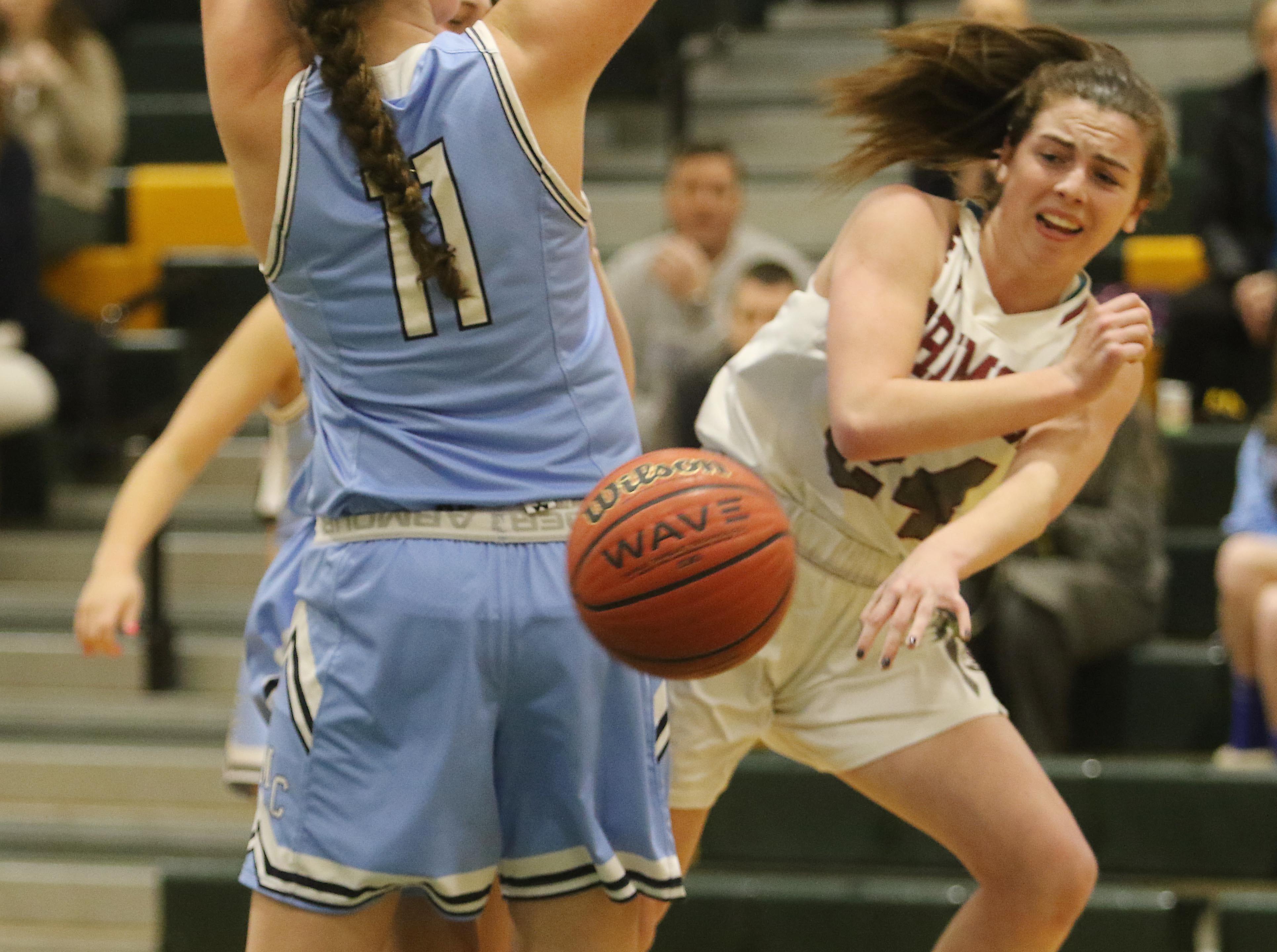 Bridget Monaghan of Morristown-Beard passes the ball away from Caroline Coleman of West Morris.