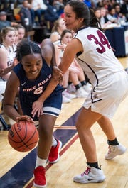 Montgomery Academy's AC Chapman (34) defends against Pike Road's Jakhiah Lewis (2) on the MA campus in Montgomery, Ala., on Friday February 8, 2019.