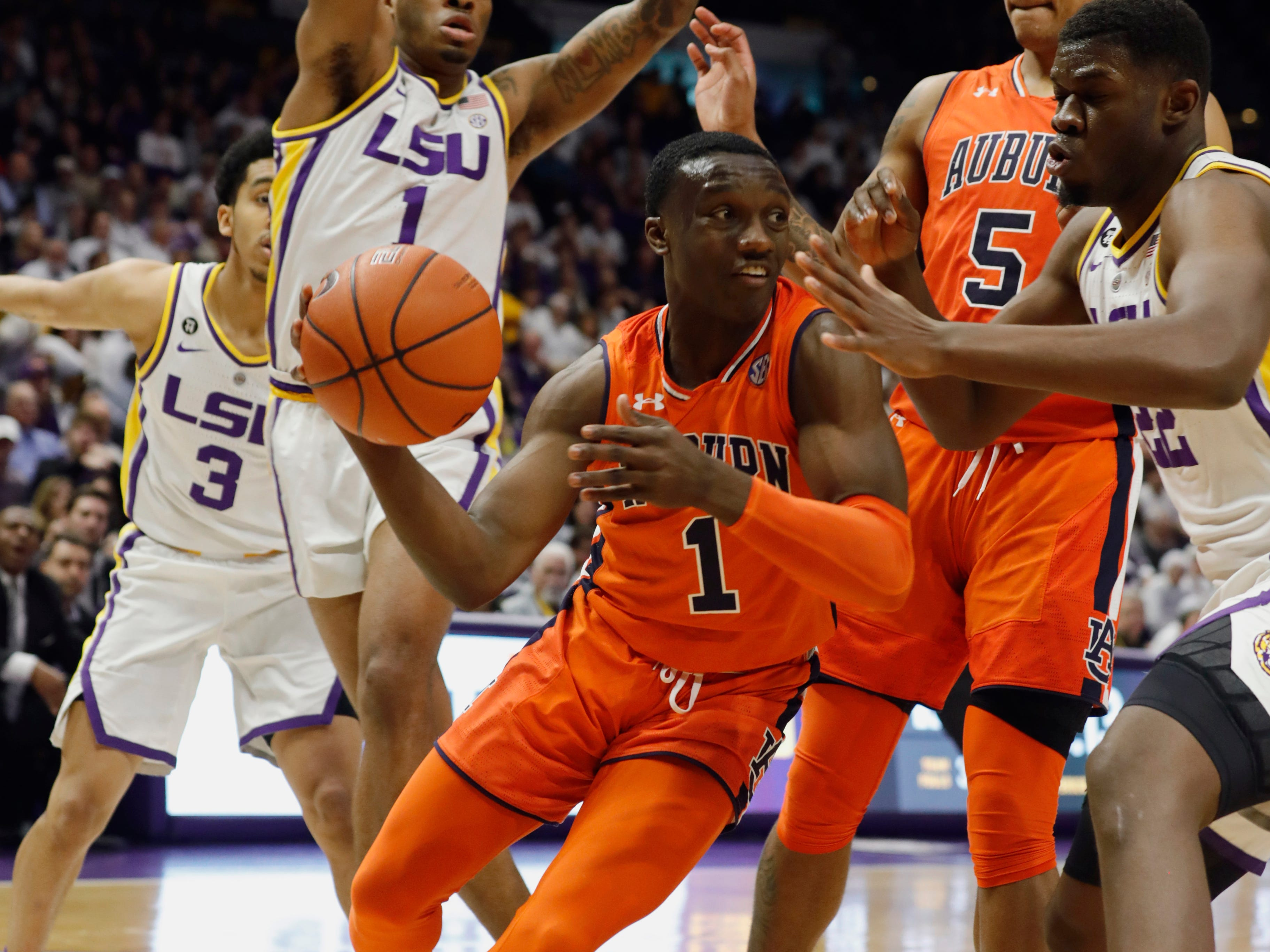 Feb 9, 2019; Baton Rouge, LA, USA; Auburn Tigers guard Jared Harper (1) dribbles against LSU Tigers guard Ja'vonte Smart (1) in the first half at Maravich Assembly Center. Mandatory Credit: Stephen Lew-USA TODAY Sports
