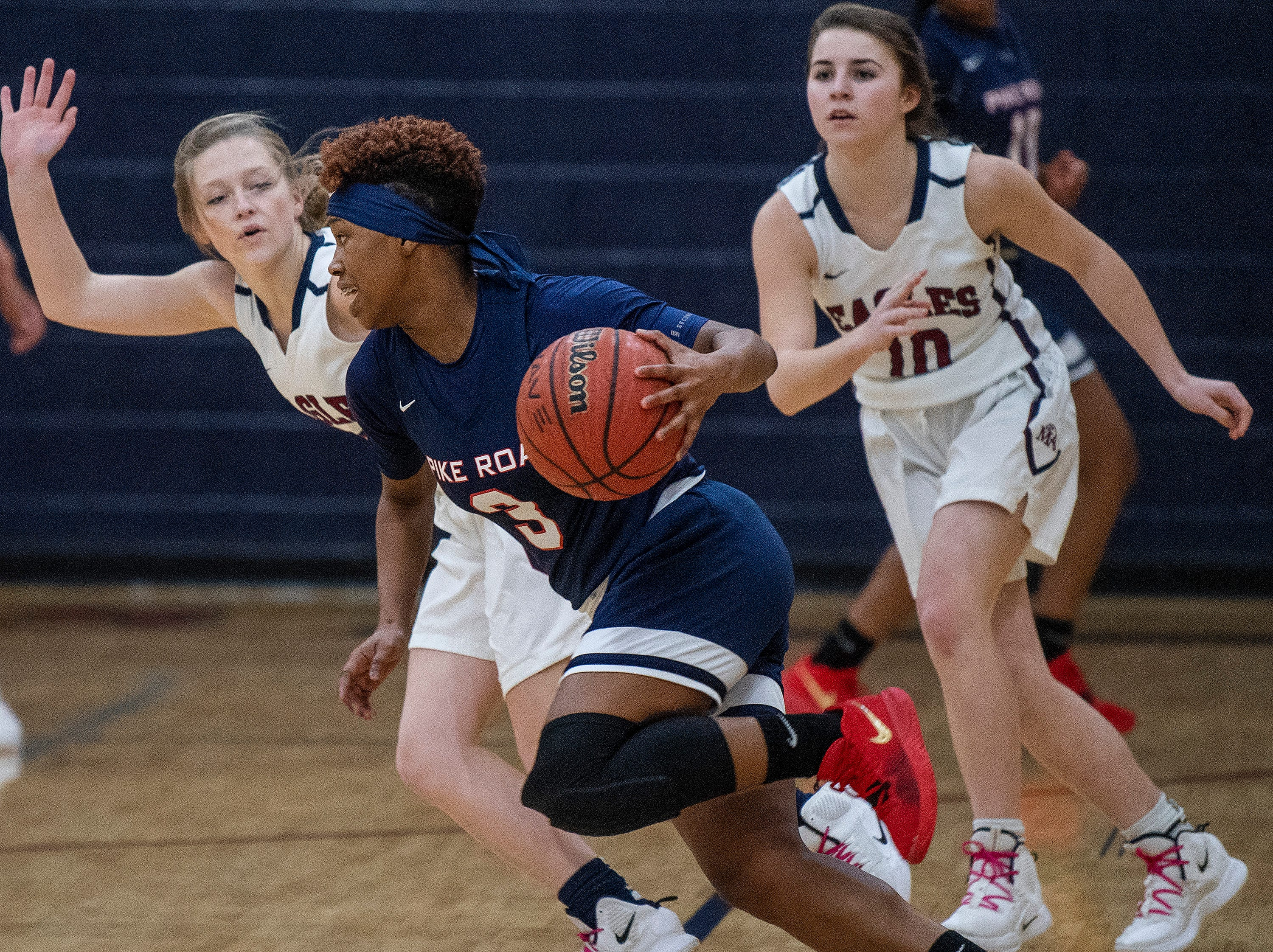 Pike Road's Sheria Clement (3) drives against Montgomery Academy's Julia Williams (2) on the MA campus in Montgomery, Ala., on Friday February 8, 2019.