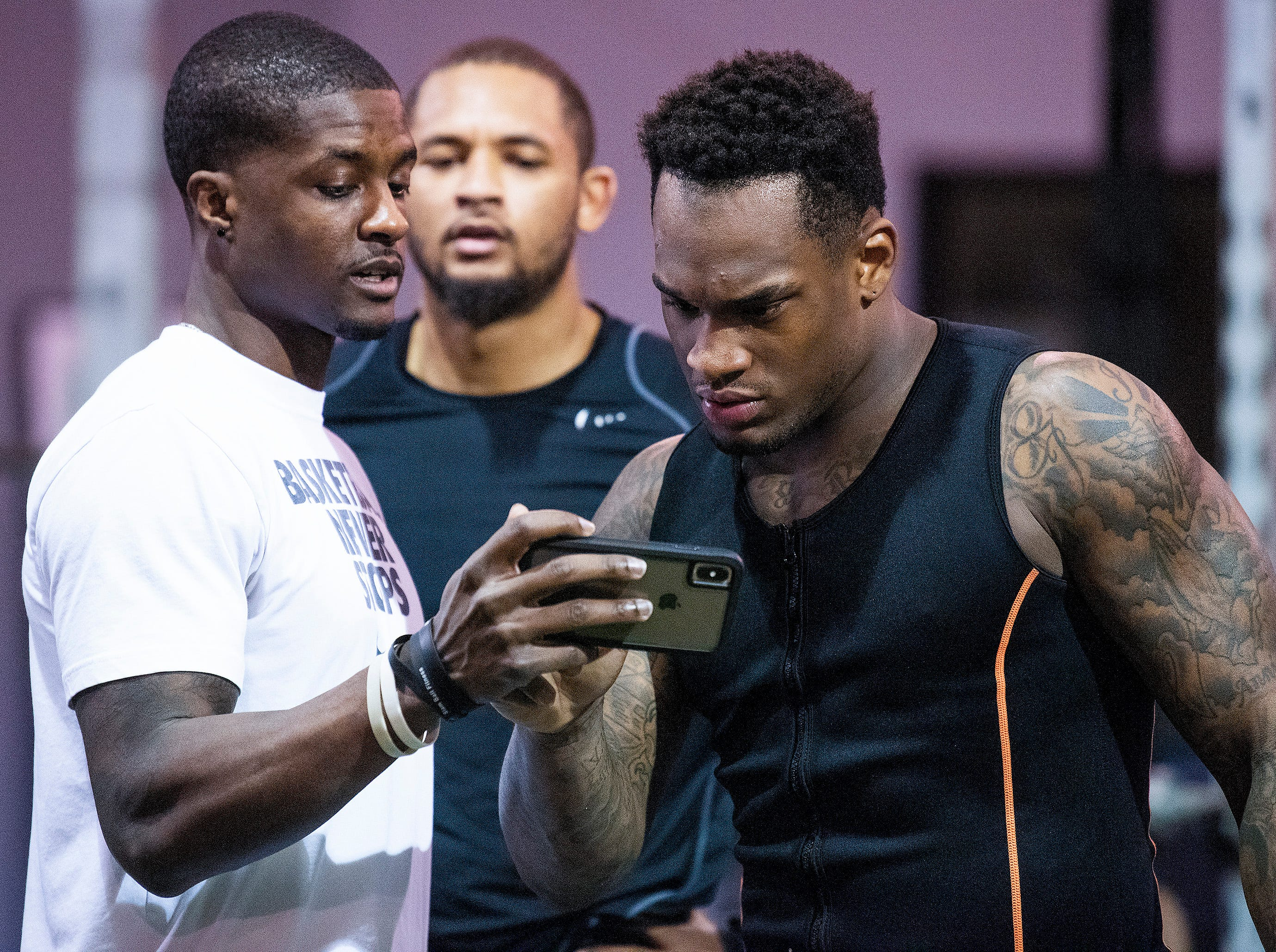 Mack Wilson examines a video of his training for the NFL Combine at MADhouse gym in Montgomery, Ala., on Saturday February 9, 2019.