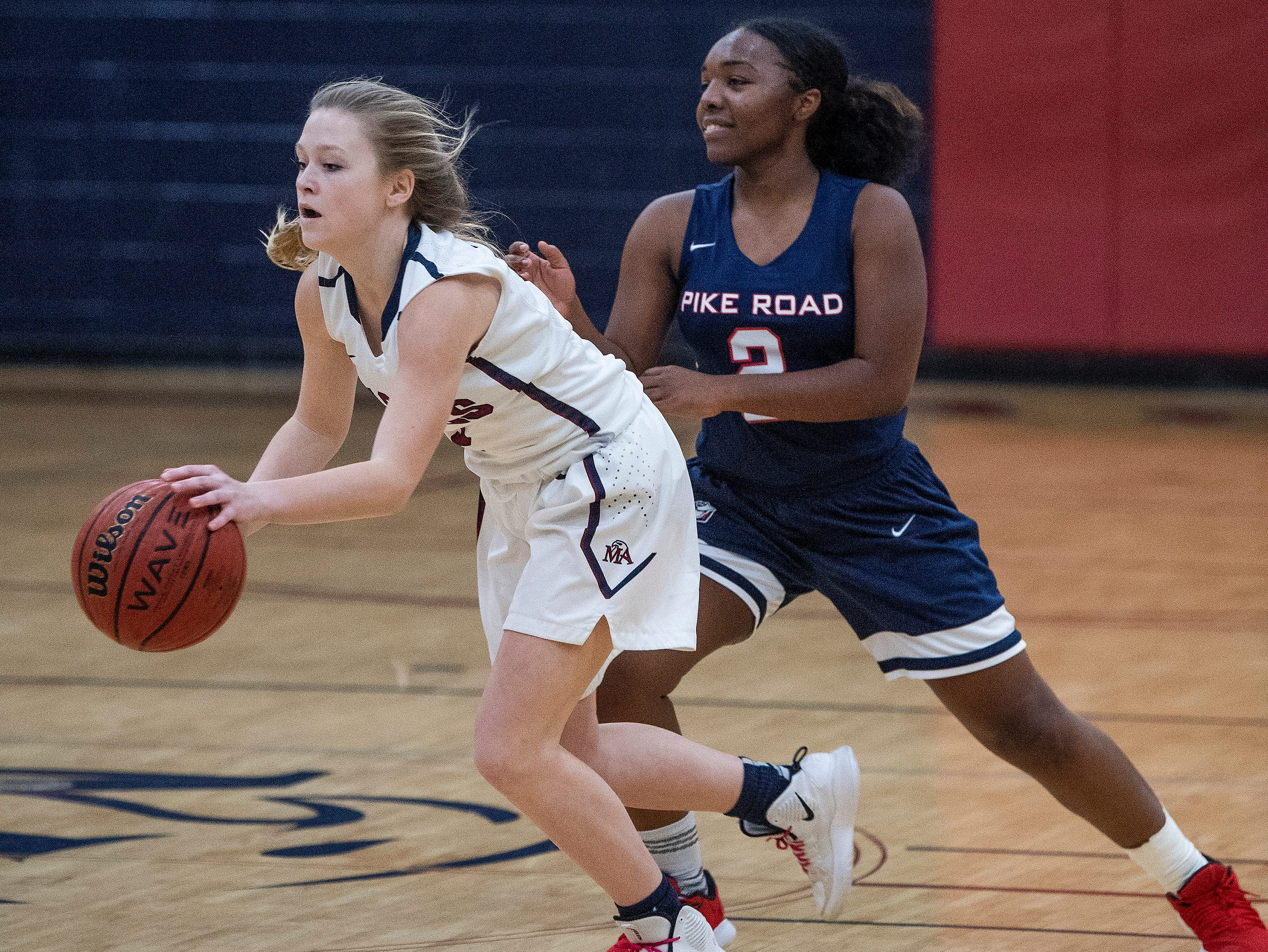 Montgomery Academy's Julia Williams (2) against Pike Road's Jakhiah Lewis (2) on the MA campus in Montgomery, Ala., on Friday February 8, 2019.