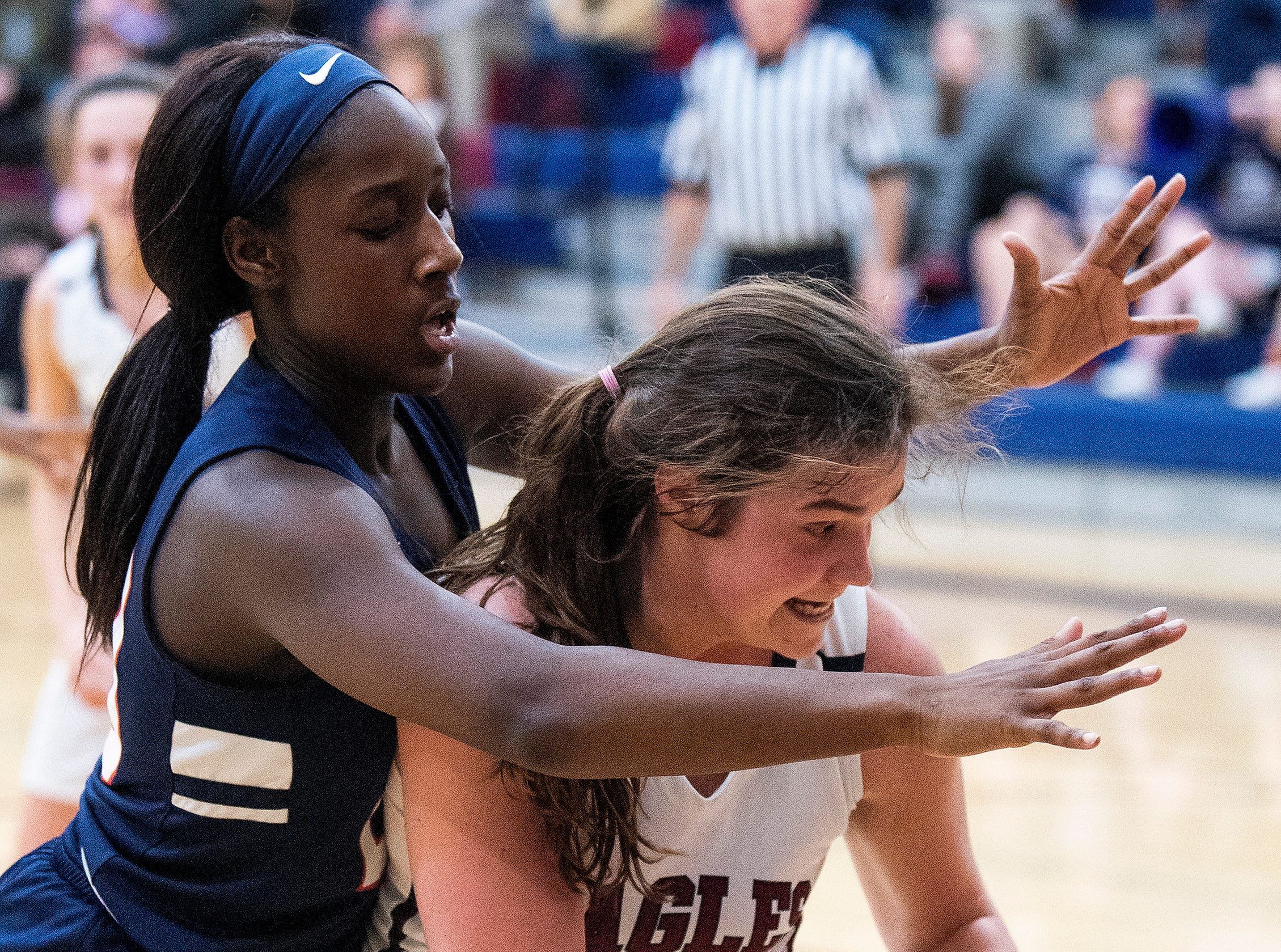 Pike Road's Tynia Rogers (23) defends against Montgomery Academy's Margaret Mead (50) on the MA campus in Montgomery, Ala., on Friday February 8, 2019.