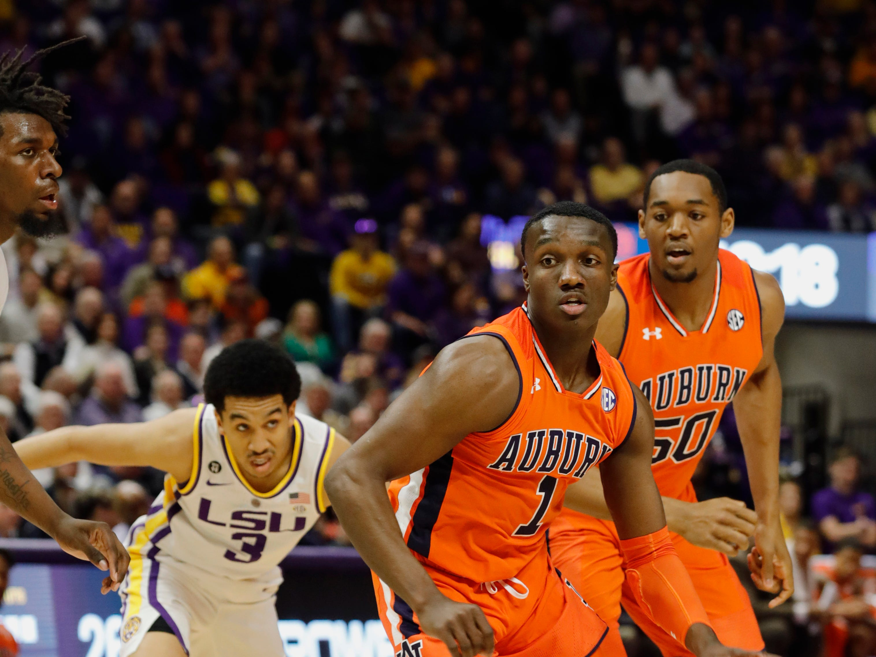 Feb 9, 2019; Baton Rouge, LA, USA; Auburn Tigers guard Jared Harper (1) dribbles against LSU Tigers guard Tremont Waters (3) in the first half at Maravich Assembly Center. Mandatory Credit: Stephen Lew-USA TODAY Sports