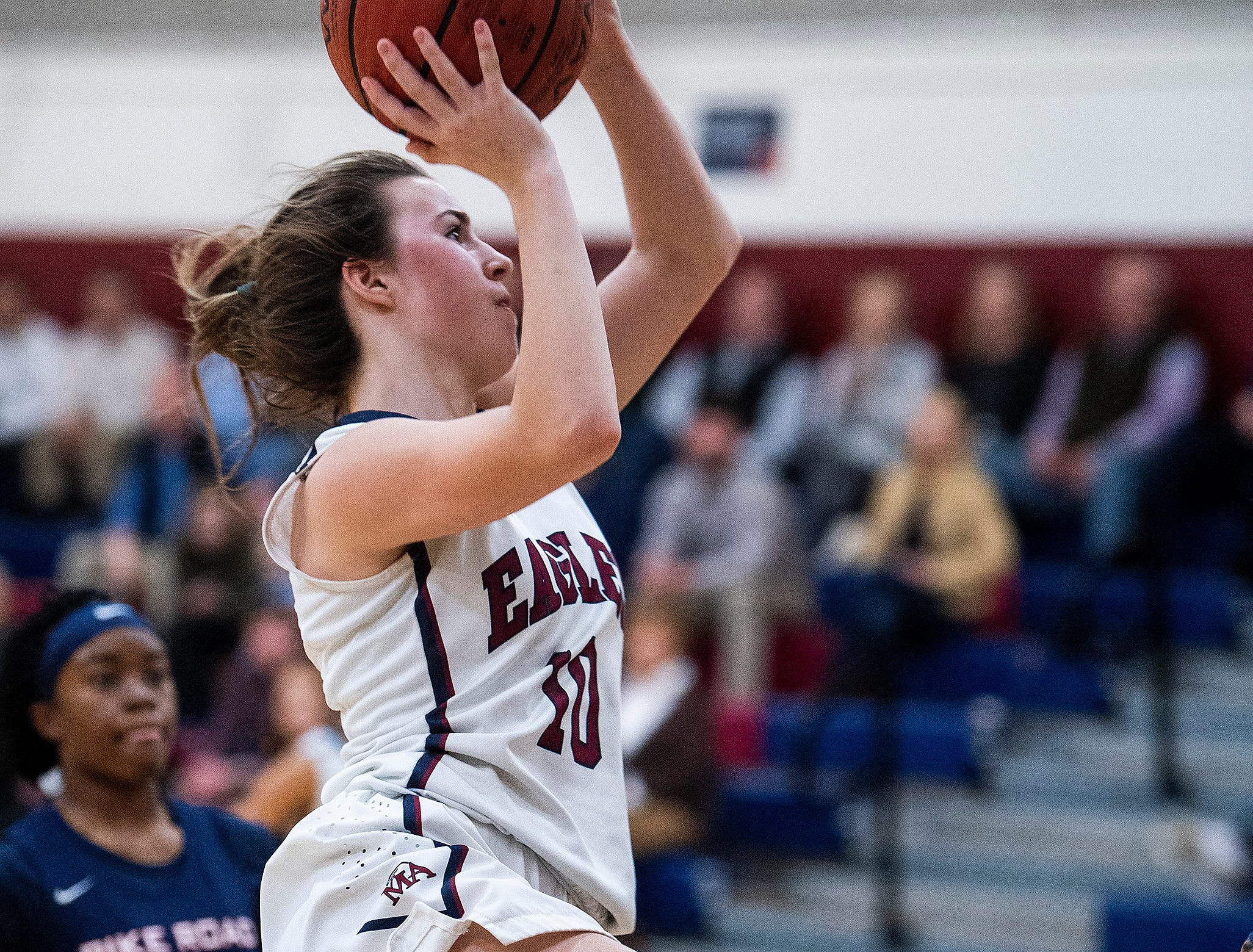 Montgomery Academy's Madisyn Caddell (10) goes hard to the basket against Pike Road on the MA campus in Montgomery, Ala., on Friday February 8, 2019.