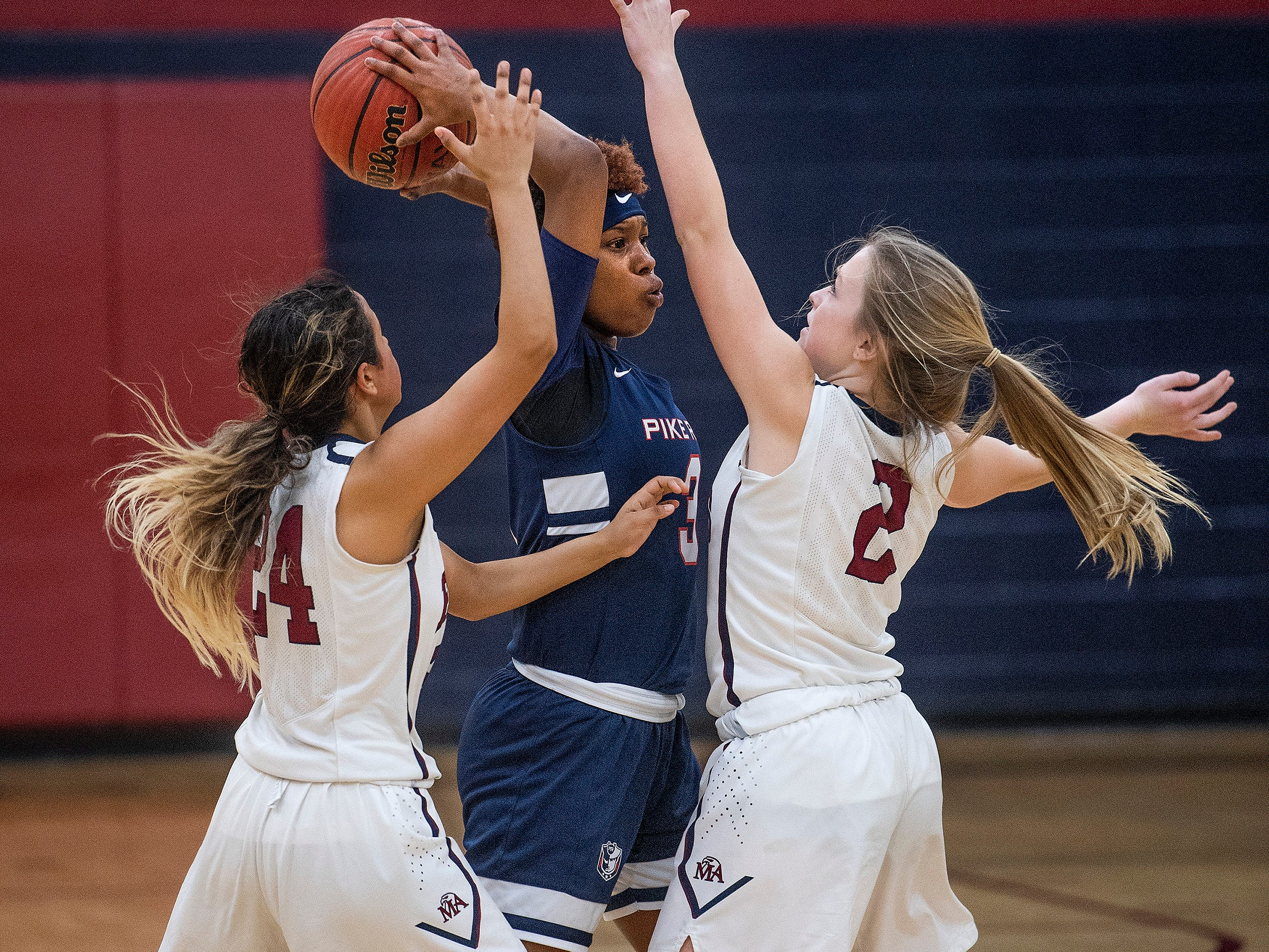 Montgomery Academy's Gabby Ramirez (24) and Julia Williams (2) double team Pike Road's Sheria Clement (3) on the MA campus in Montgomery, Ala., on Friday February 8, 2019.
