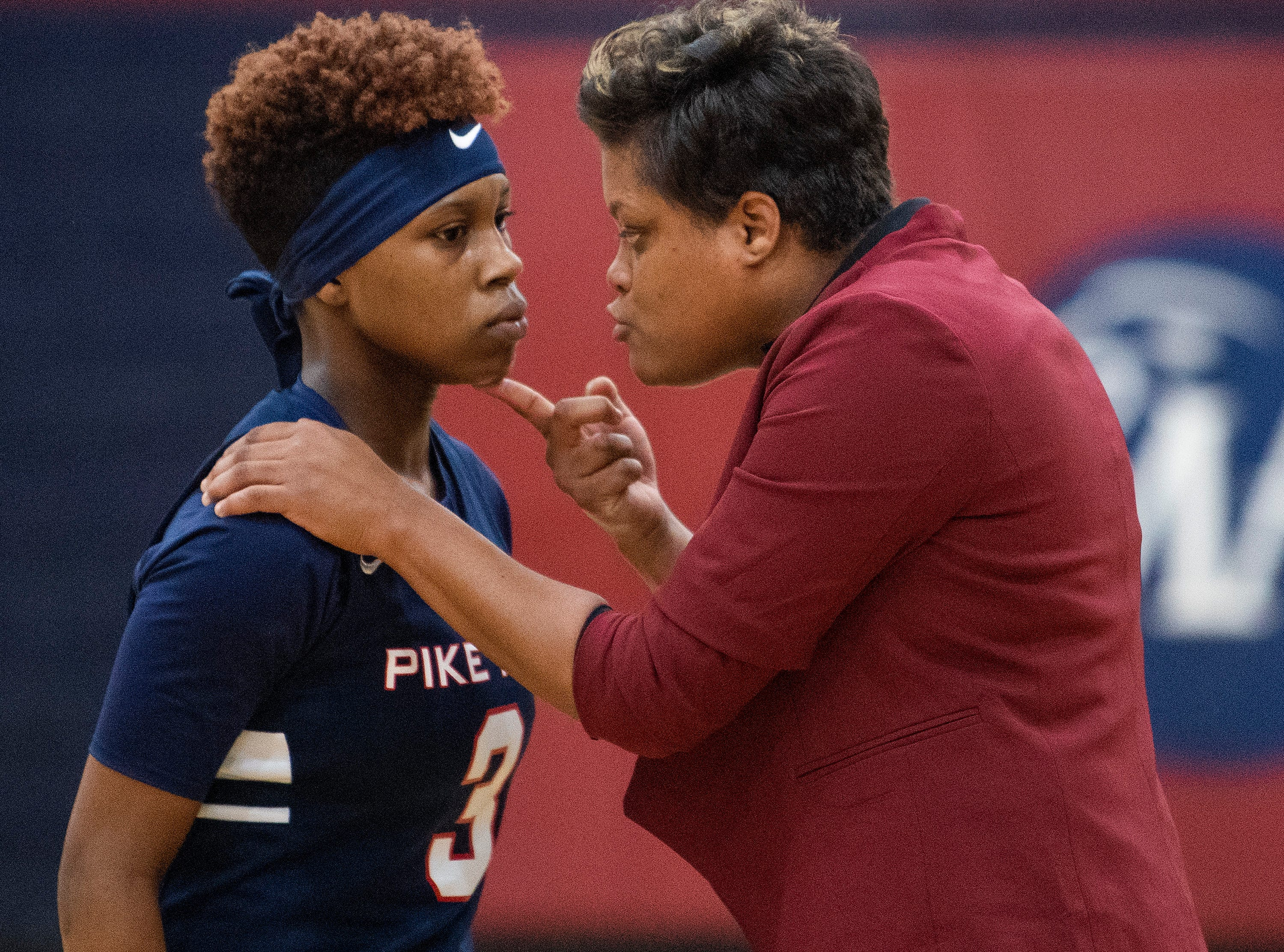 Pike Road coach Courtney Ward coaches Sheria Clement (3) against Montgomery Academy on the MA campus in Montgomery, Ala., on Friday February 8, 2019.
