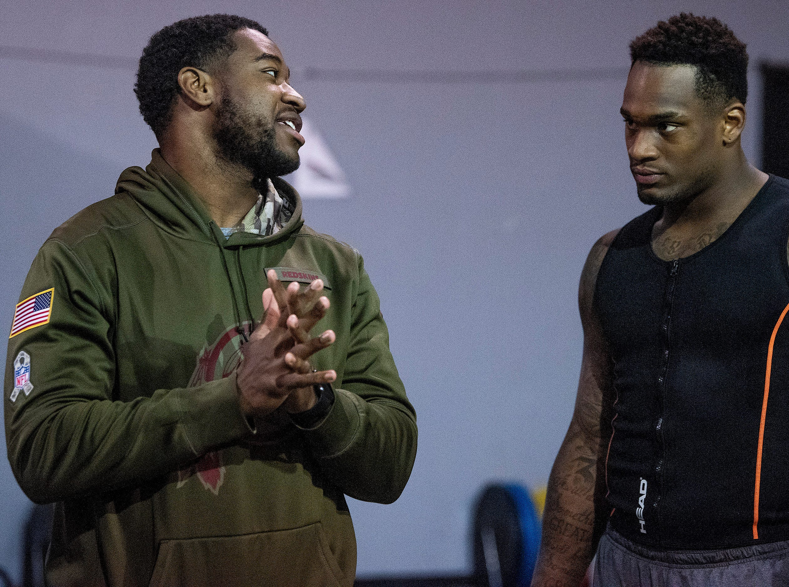 Mack Wilson talks with former teammate current NFL player Shaun Dion Hamilton as he trains for the NFL Combine at MADhouse gym in Montgomery, Ala., on Saturday February 9, 2019.