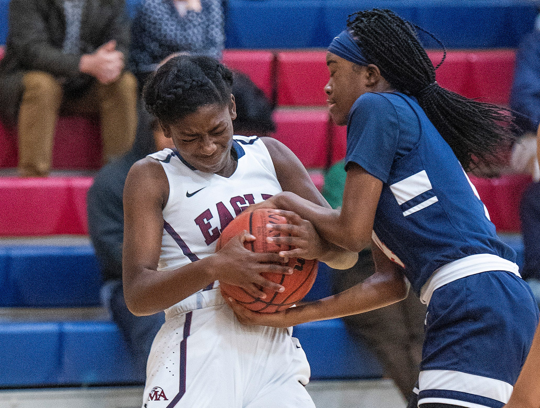 Montgomery Academy's Katherine Yelverton (12) and Pike Road's Aaliyah Manora (4) fight for the ball on the MA campus in Montgomery, Ala., on Friday February 8, 2019.