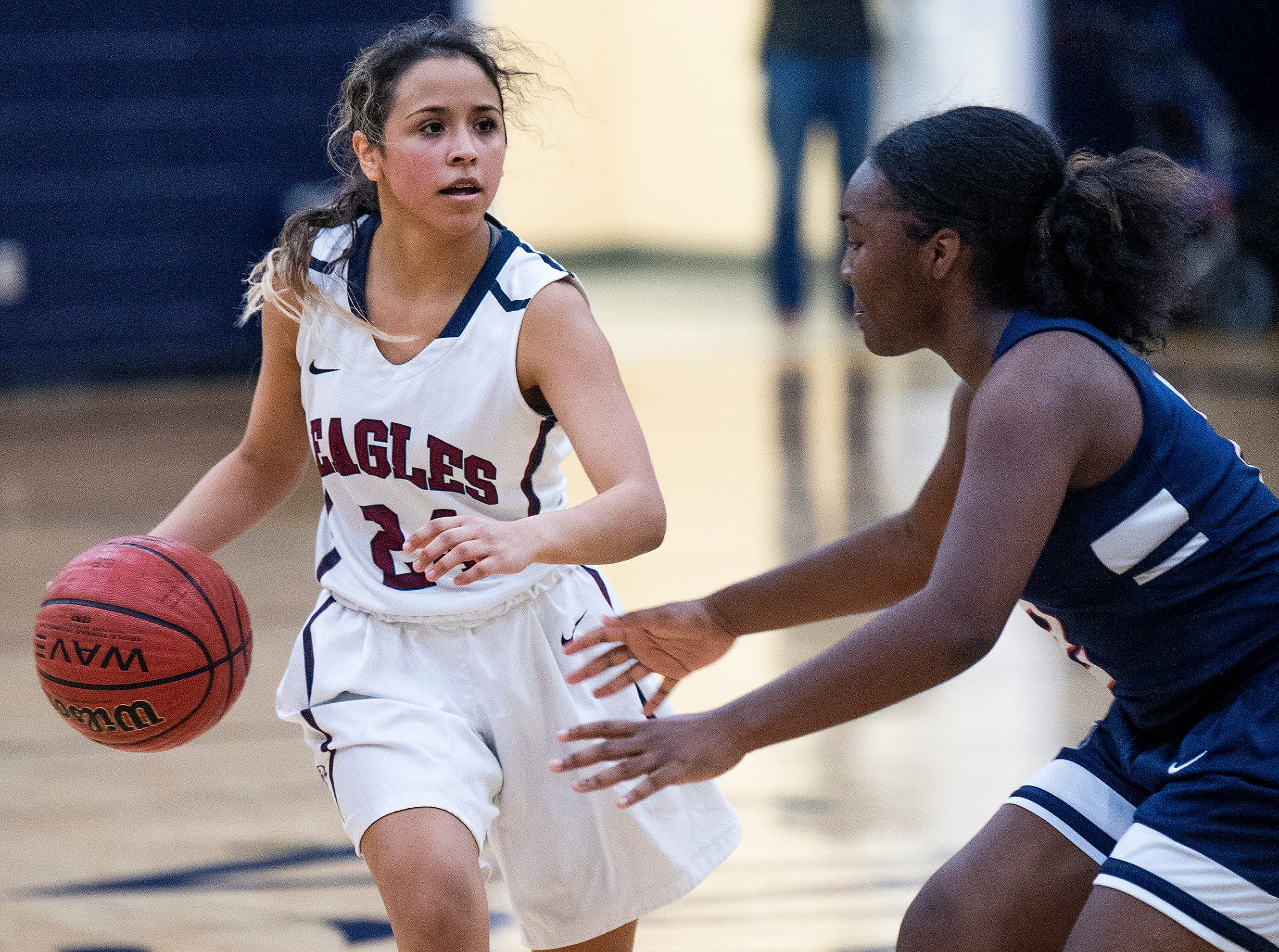 Montgomery Academy's Gabby Ramirez (24) is defended by Pike Road's Jakhiah Lewis (2) on the MA campus in Montgomery, Ala., on Friday February 8, 2019.