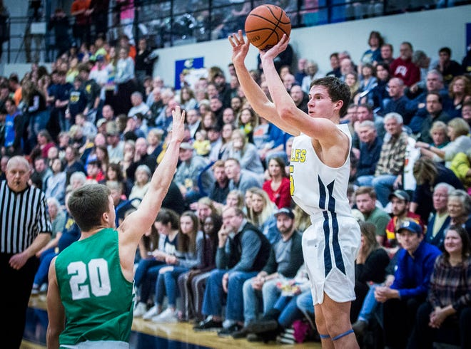 Delta's Josh Bryan shoots against New Castle during their game at Delta High School Friday, Feb. 8, 2019.
