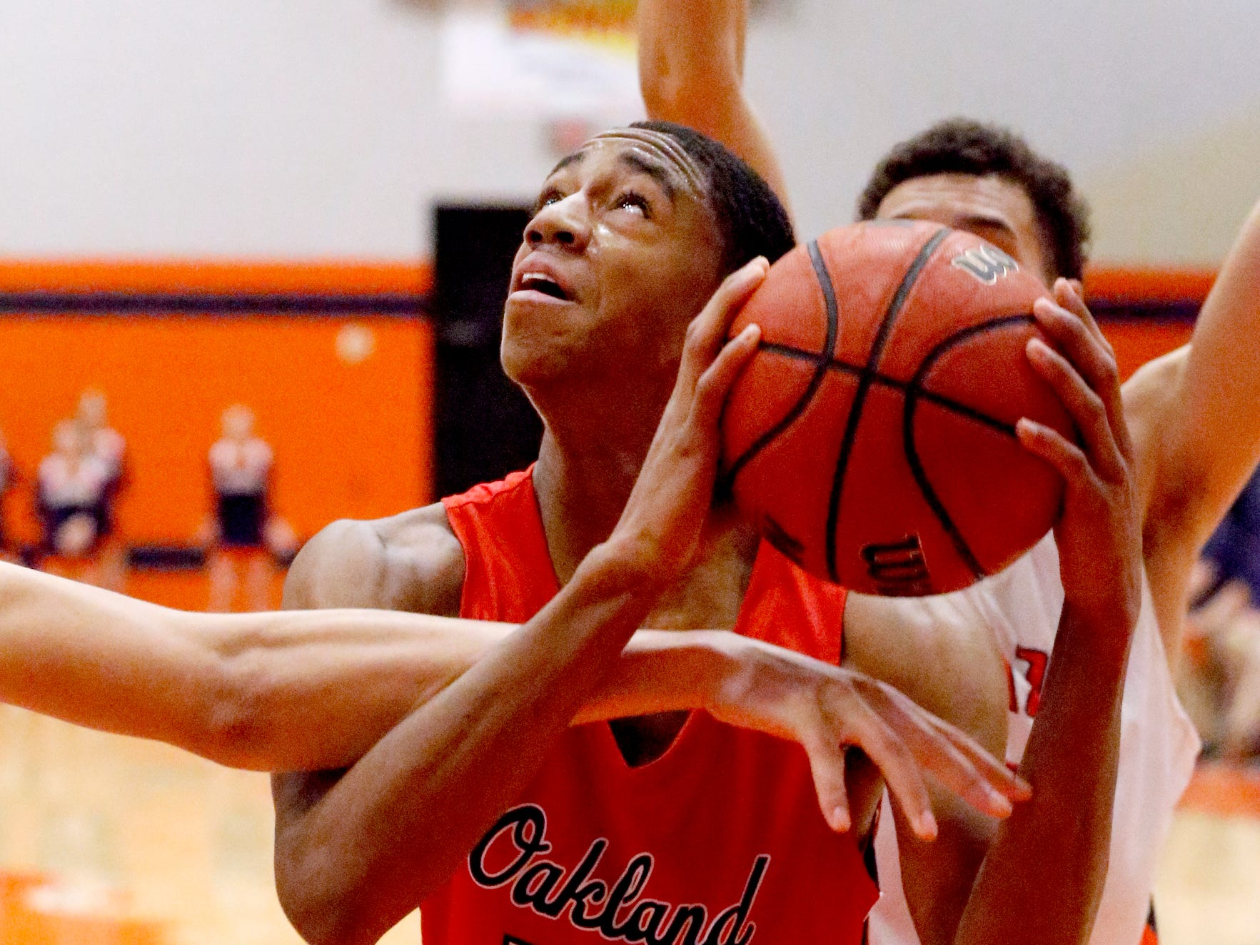 Oakland's DD Anderson (23) is fouled as he goes up for a shot during the game against Blackman on Friday, Feb. 8, 2019.