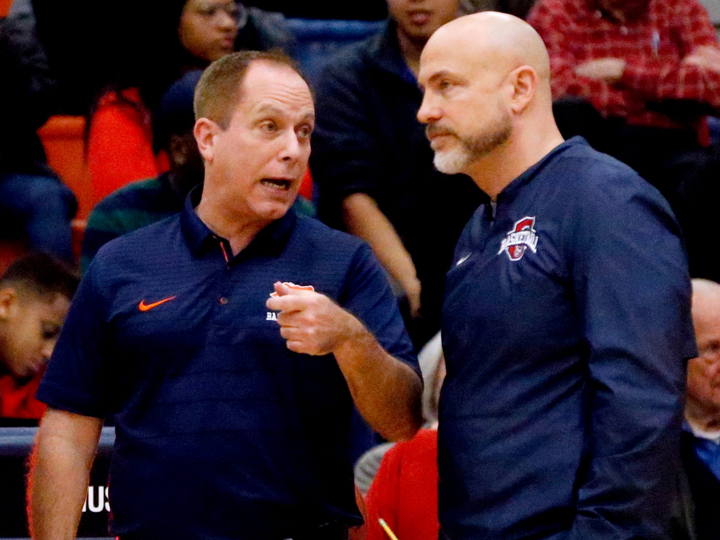 Blackman's head coach Barry Wortman and Oakland's head coach Troy Bond talk before the game on Friday, Feb. 8, 2019.