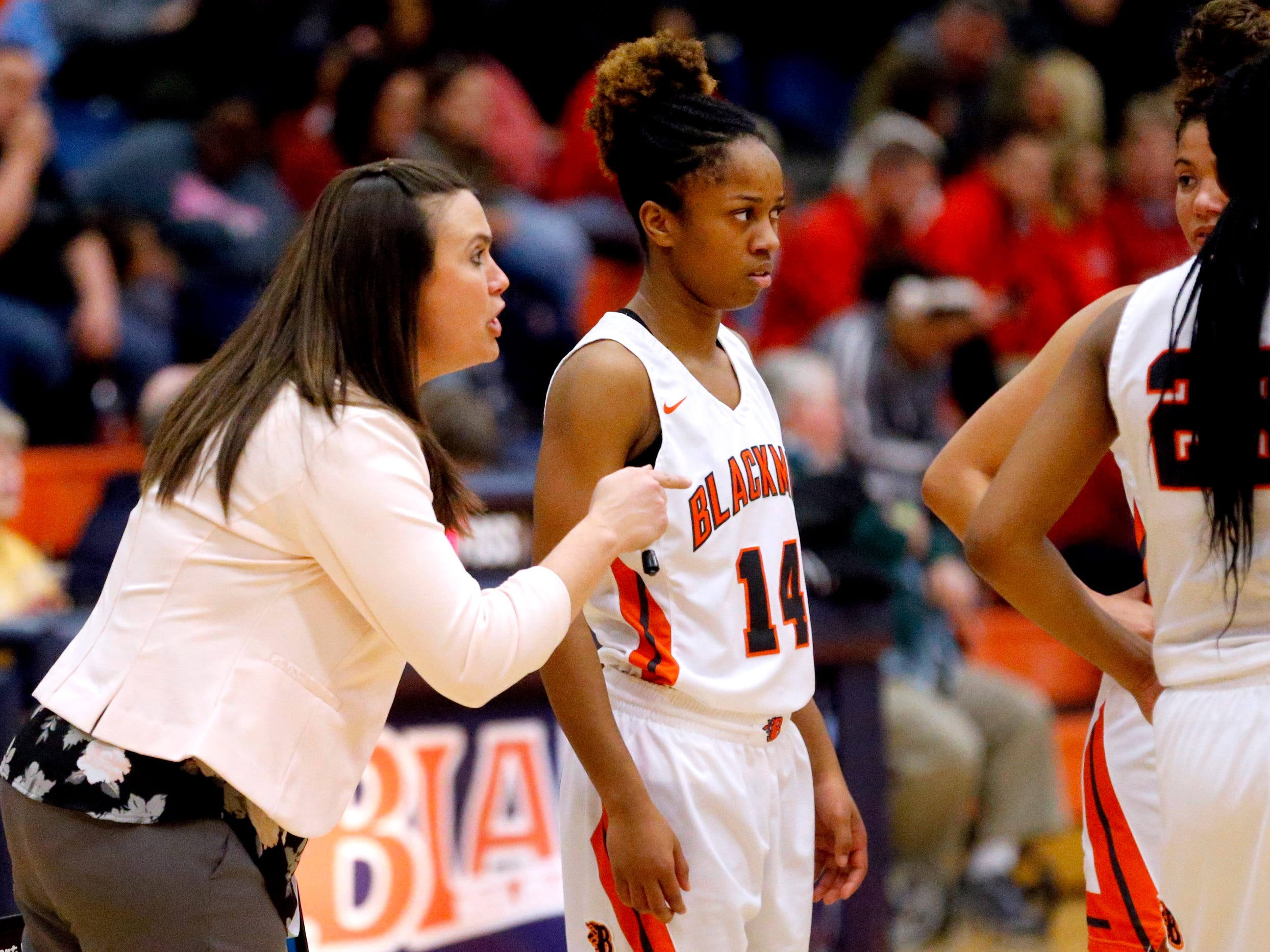 Blackman's head coach Wendi Scott talks with Blackman's Joelle Patton (14)  during a break in the game against Oakland on Friday, Feb. 8, 2019.