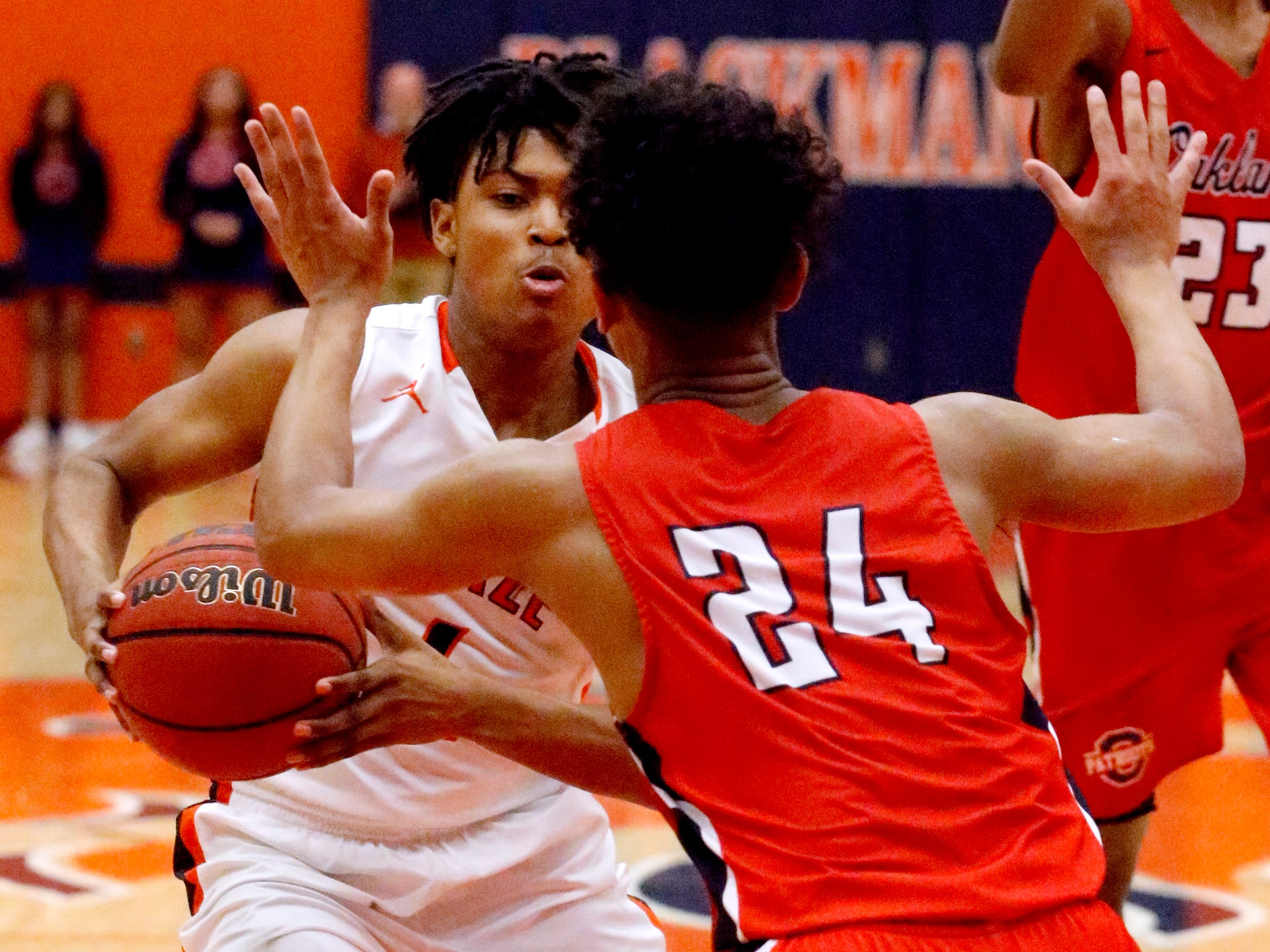 Blackman's TJ Cross (4) drives to the basket s Oakland's Jaden Jamison (24) guards him on Friday, Feb. 8, 2019.