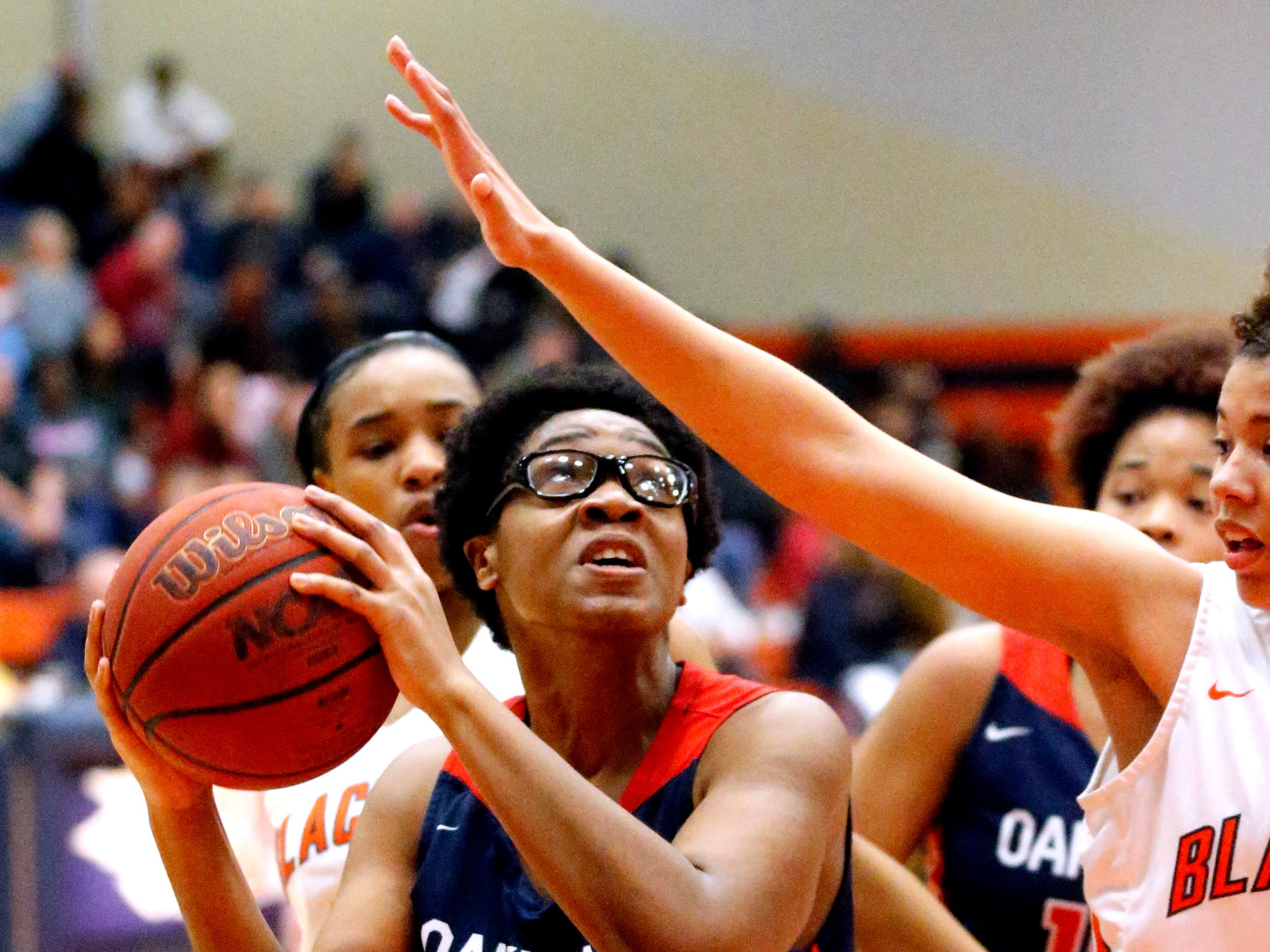 Oakland's Nicole Egeruoh (42) goes up for a shot during the game against Blackman on Friday, Feb. 8, 2019.