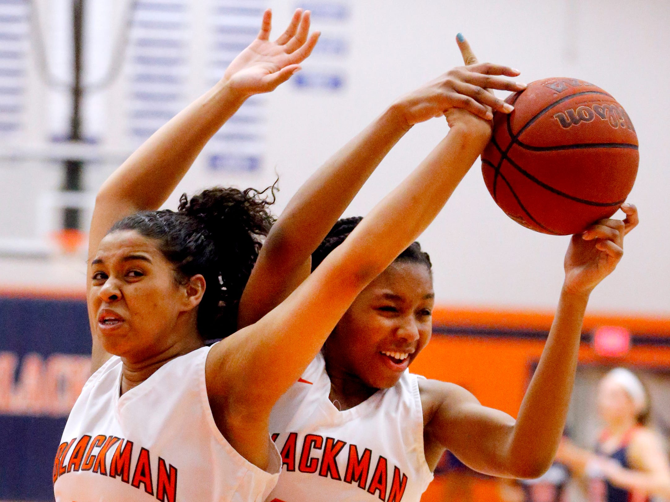 Blackman's Aaliyah Green (25) and Iyana Moore (23) both go after a rebound during the game against Oakland on Friday, Feb. 8, 2019.