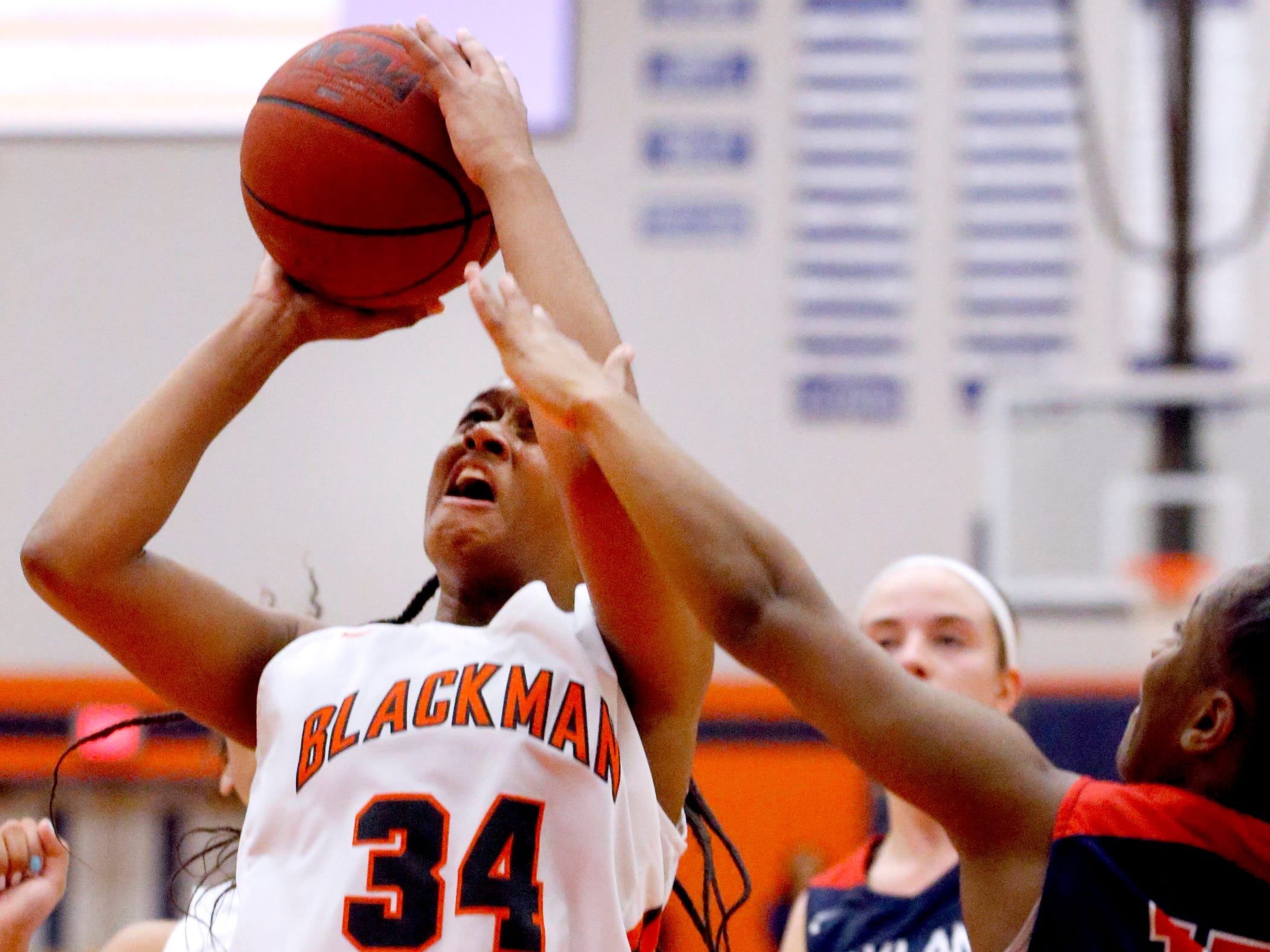 Blackman's Geegee Hollingsworth (34) goes up for a shot as Oakland's Dakoria Puckett (10) guards her during the game against Oakland on Friday, Feb. 8, 2019.