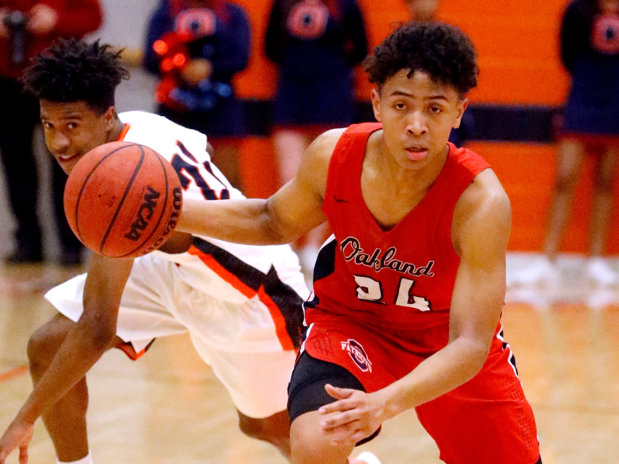 Oakland's Jaden Jamison (24) steals the ball away from Blackman's Todd Lark (21) on Friday, Feb. 8, 2019.