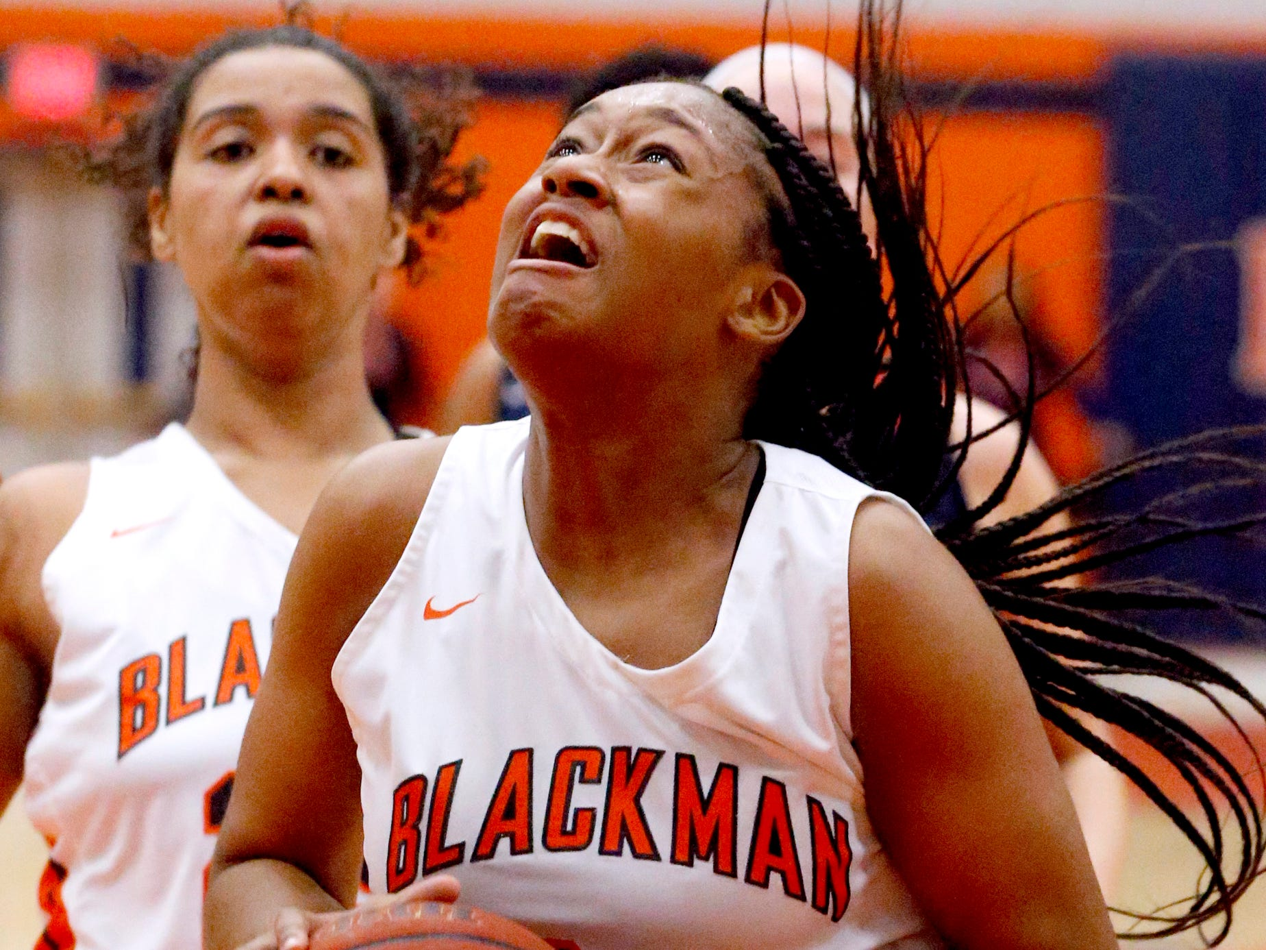 Blackman's Geegee Hollingsworth (34) grabs the rebound and goes up for a shot during the game against Oakland on Friday, Feb. 8, 2019.