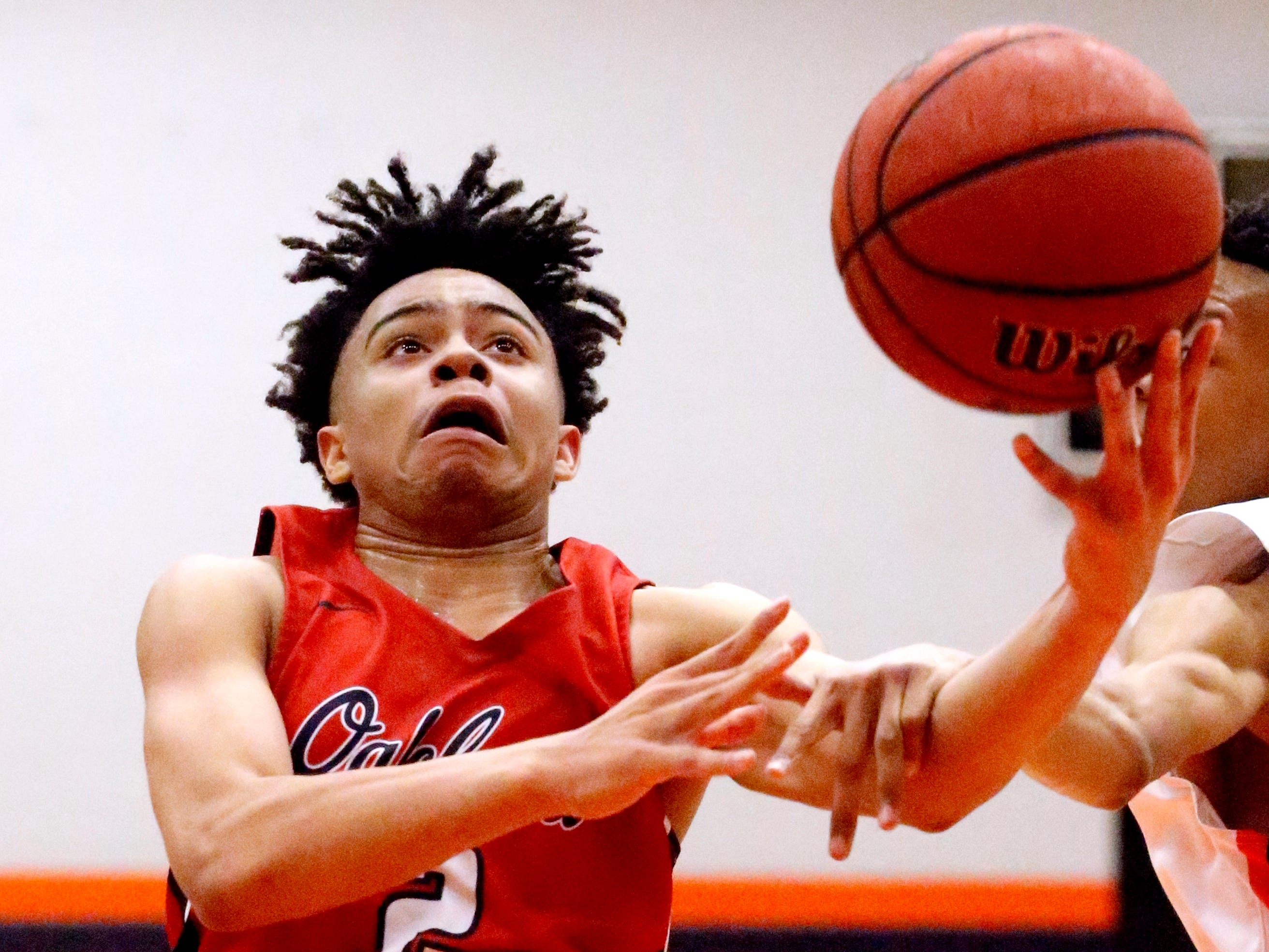 Oakland's Ray Tyler (2) is fouled as he goes up for a shot during the game against Blackman on Friday, Feb. 8, 2019.