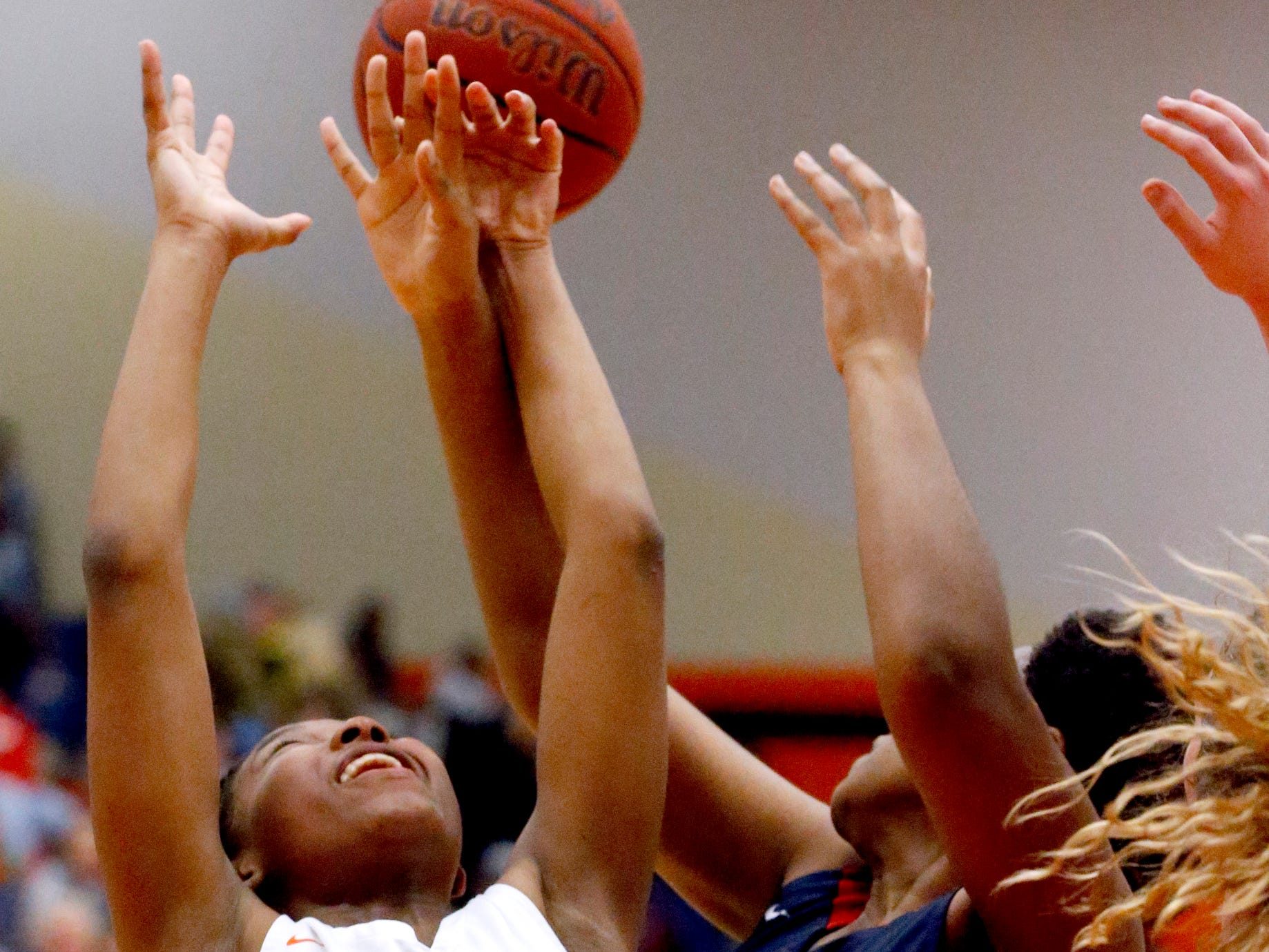 Blackman's Iyana Moore (23) goes for a rebound during the game against Oakland on Friday, Feb. 8, 2019.