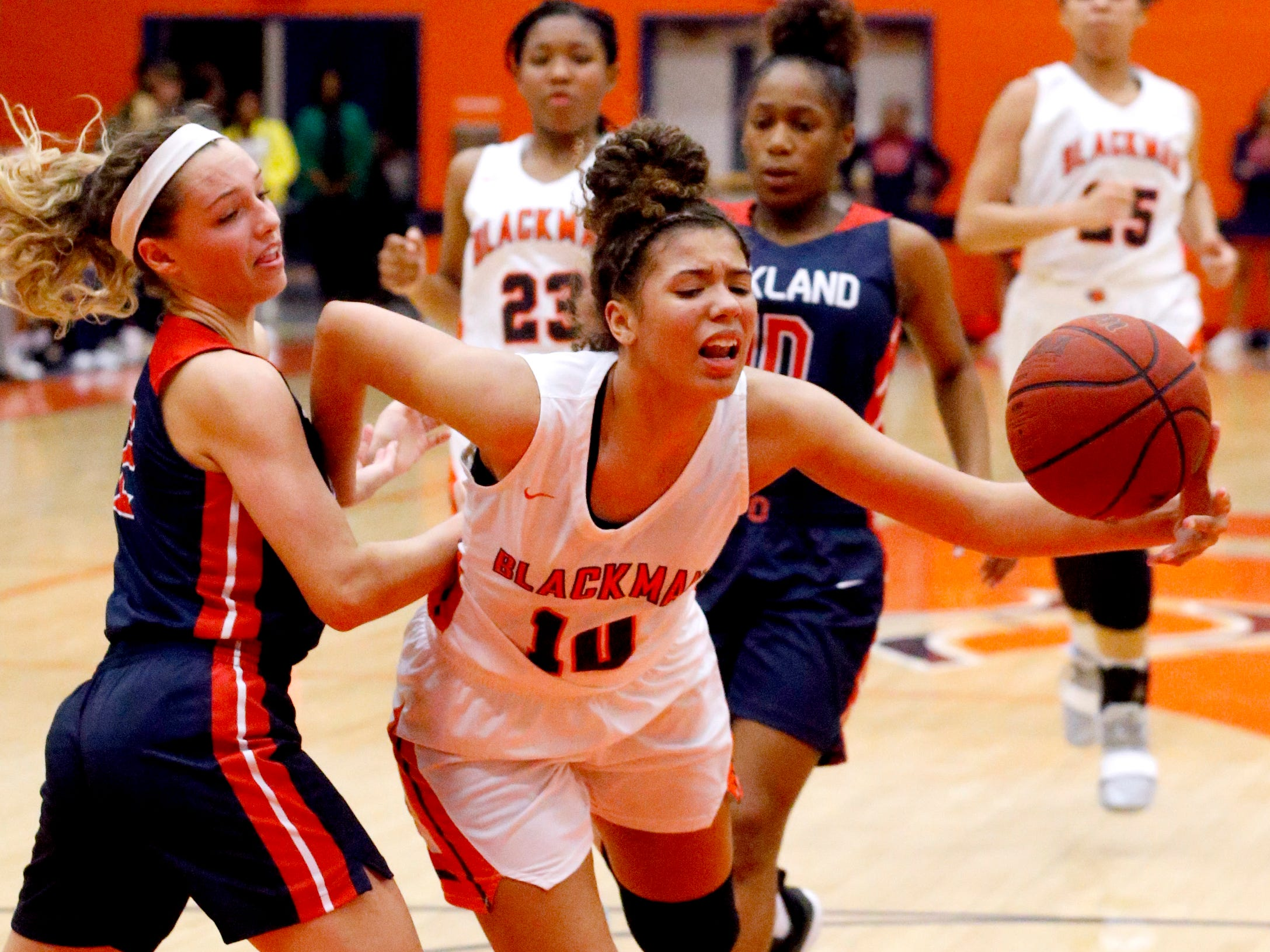 Blackman's Jaida Bond (10) goes up for a shot as she is fouled by Oakland's Faith Adams (2) on Friday, Feb. 8, 2019.