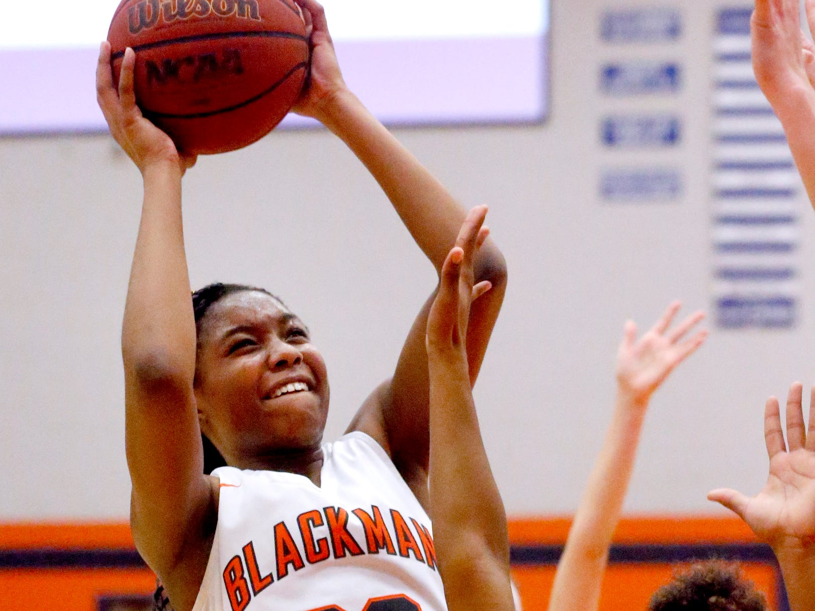 Blackman's Iyana Moore (23) goes up for a shot as Oakland's Dakoria Puckett (10) guards her on Friday, Feb. 8, 2019.