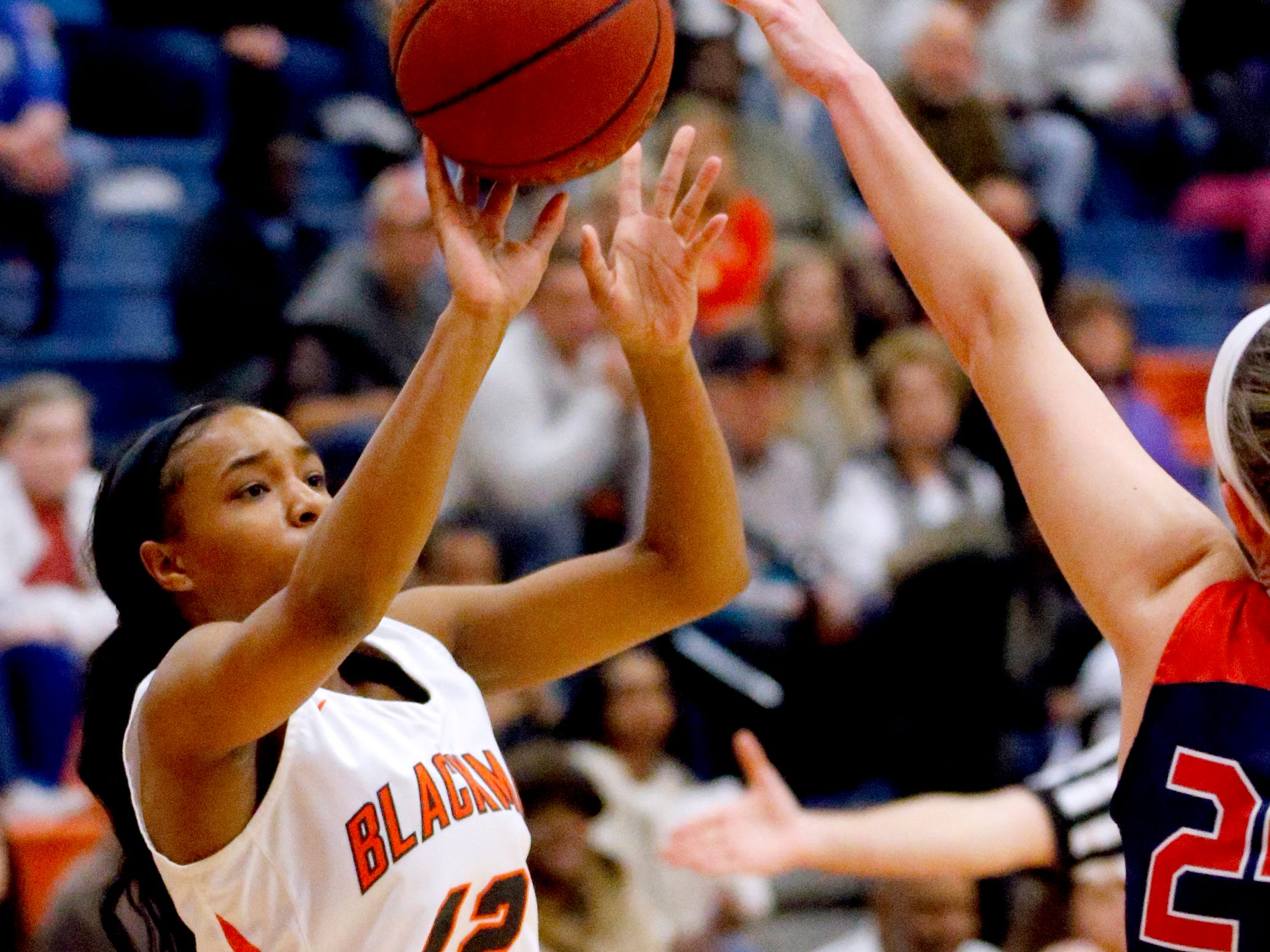 Blackman's Nia Vanzant (12) shoots the ball as Oakland's Olivia Perry (24) defends her on Friday, Feb. 8, 2019.