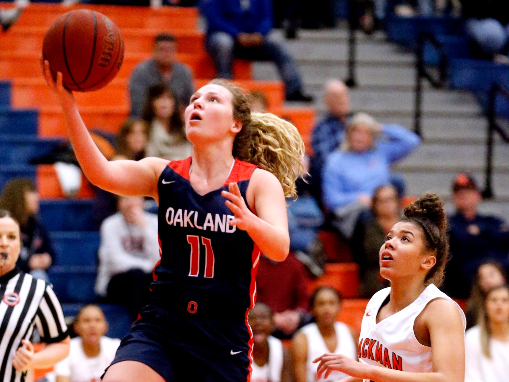 Oakland's Claira McGowan (11) got up for a shot as Blackman's Jaida Bond (10) comes up from behind her on Friday, Feb. 8, 2019.