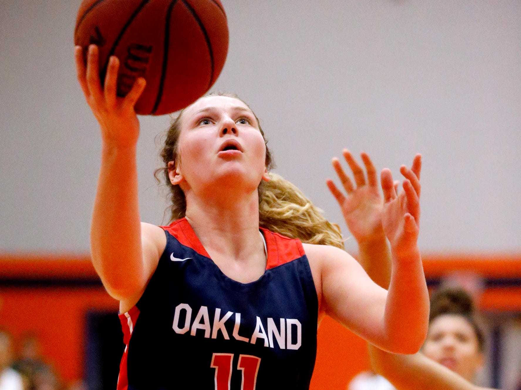 Oakland's Claira McGowan (11) goes up for a shot during the game against Blackman on Friday, Feb. 8, 2019.