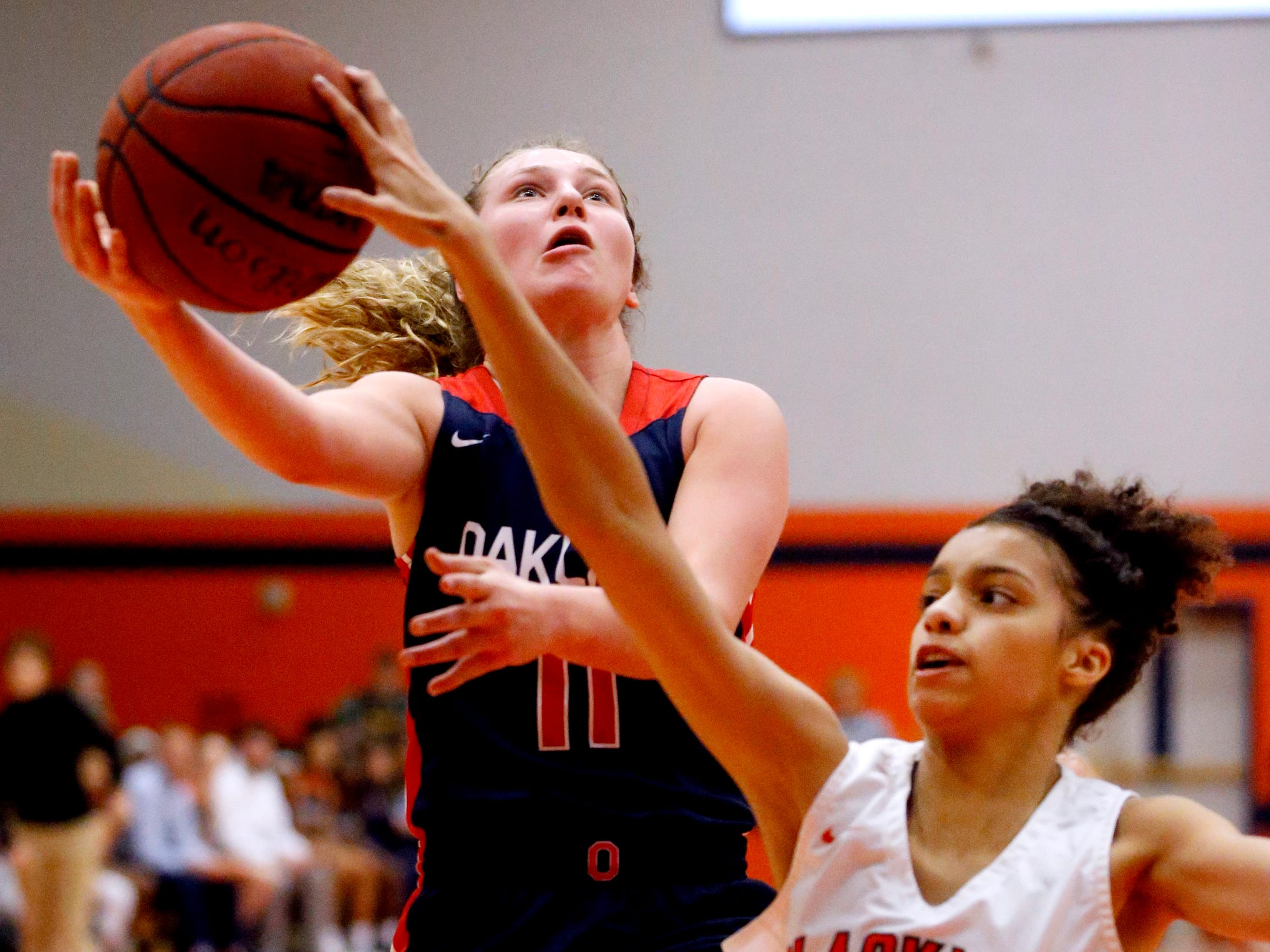 Blackman's Faith Anderson (11) got up for a shot as Blackman's Victoria Page (15) guards her on Friday, Feb. 8, 2019.