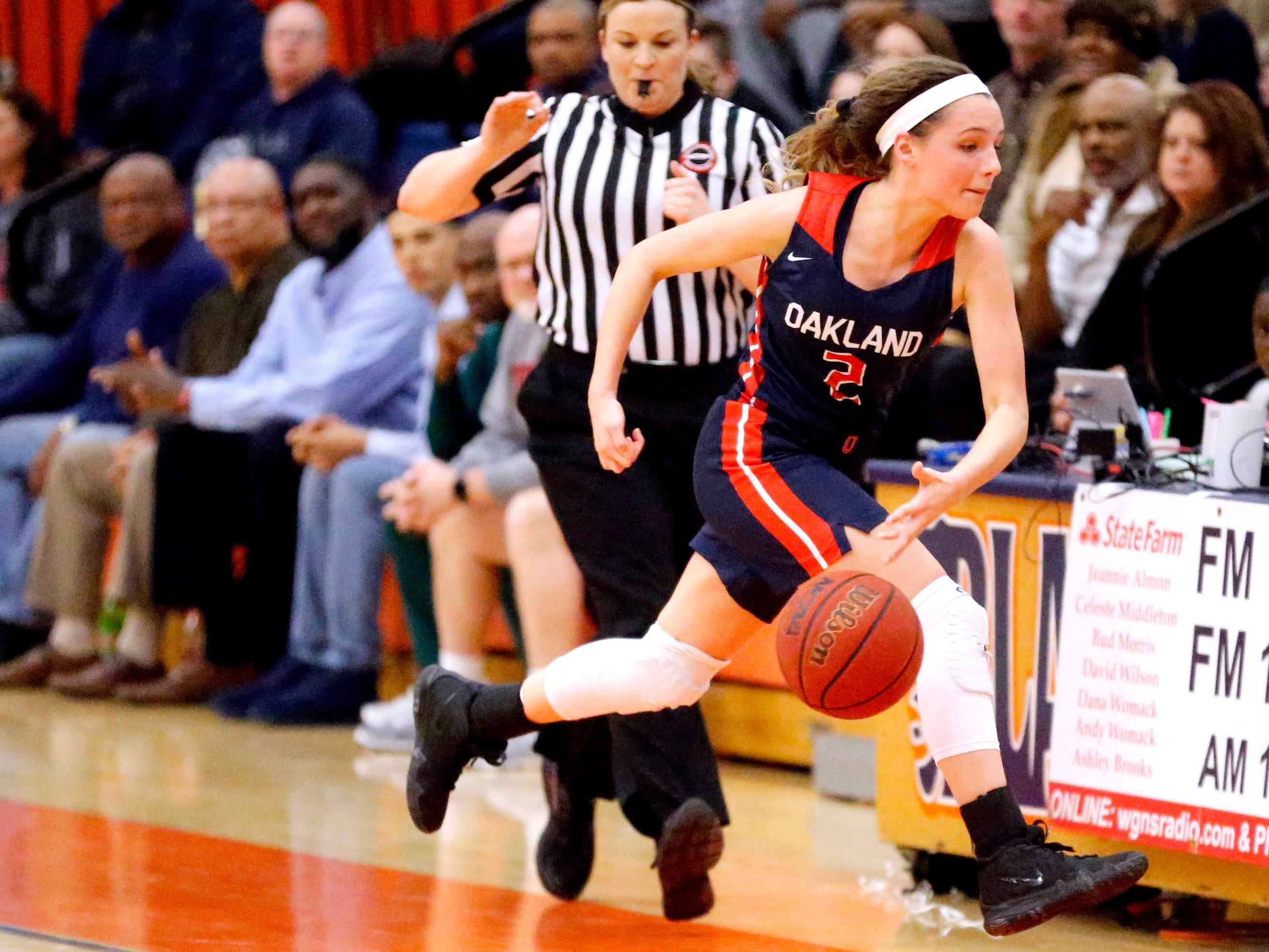 Oakland's Faith Adams (2) tries to hit the ball back into bounds before she goes out of bounds during the game against Blackman on Friday, Feb. 8, 2019.