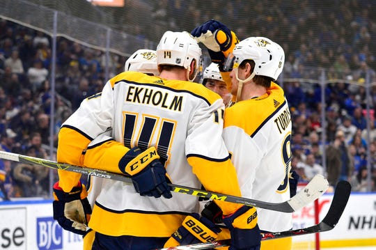 Feb 9, 2019; St. Louis, MO, USA; Nashville Predators defenseman Mattias Ekholm (14) is congratulated by teammates after scoring during the second period against the St. Louis Blues at Enterprise Center. Mandatory Credit: Jeff Curry-USA TODAY Sports