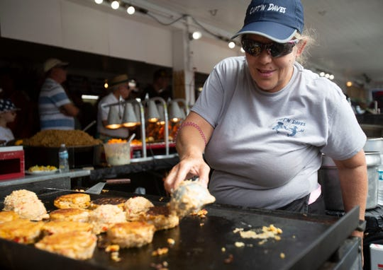 Denine Priddy, of Port St. Lucie, prepares crab cakes during the 49th annual Everglades City Seafood festival in Everglades City on Saturday.