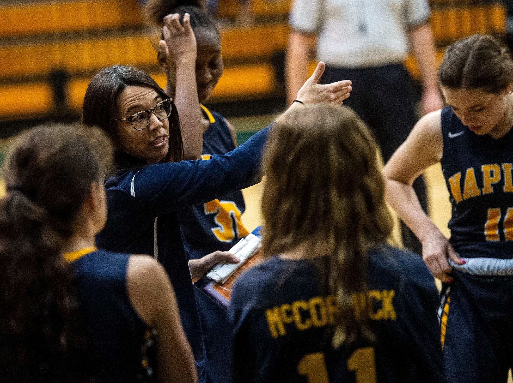 Naples High School head coach Daniella Rosset talks with her team during the Class 7A-District 12 Championship against Barron Collier High School in Naples, Fla., on Friday, Feb. 8, 2019.