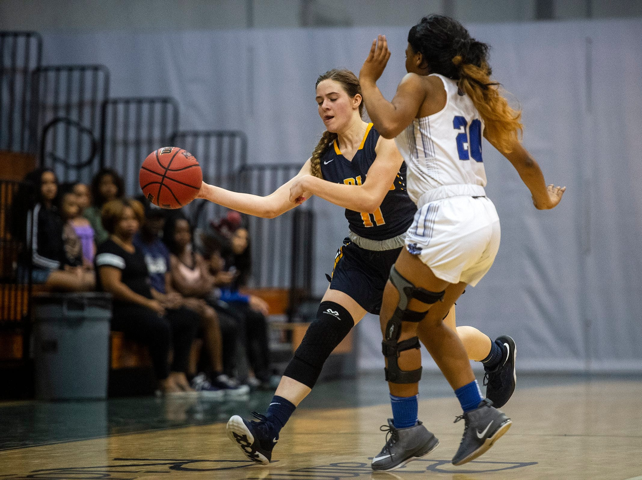 Naples High School's Molly Richards tries to get past defense during the Class 7A-District 12 Championship against Barron Collier High School in Naples, Fla., on Friday, Feb. 8, 2019.