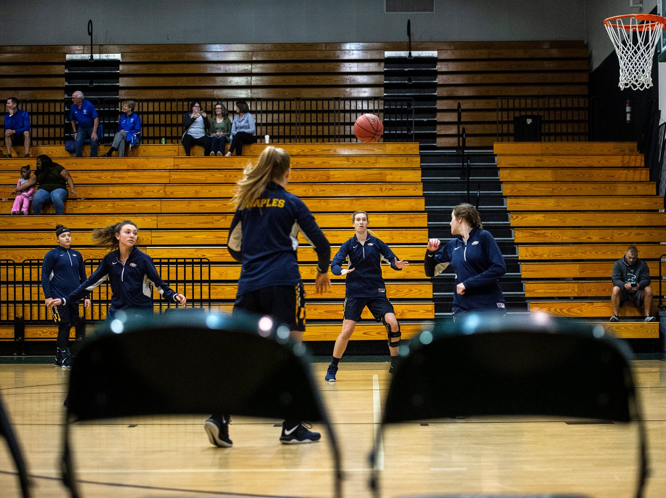 Naples High School warms up during the Class 7A-District 12 Championship in Naples, Fla., on Friday, Feb. 8, 2019.