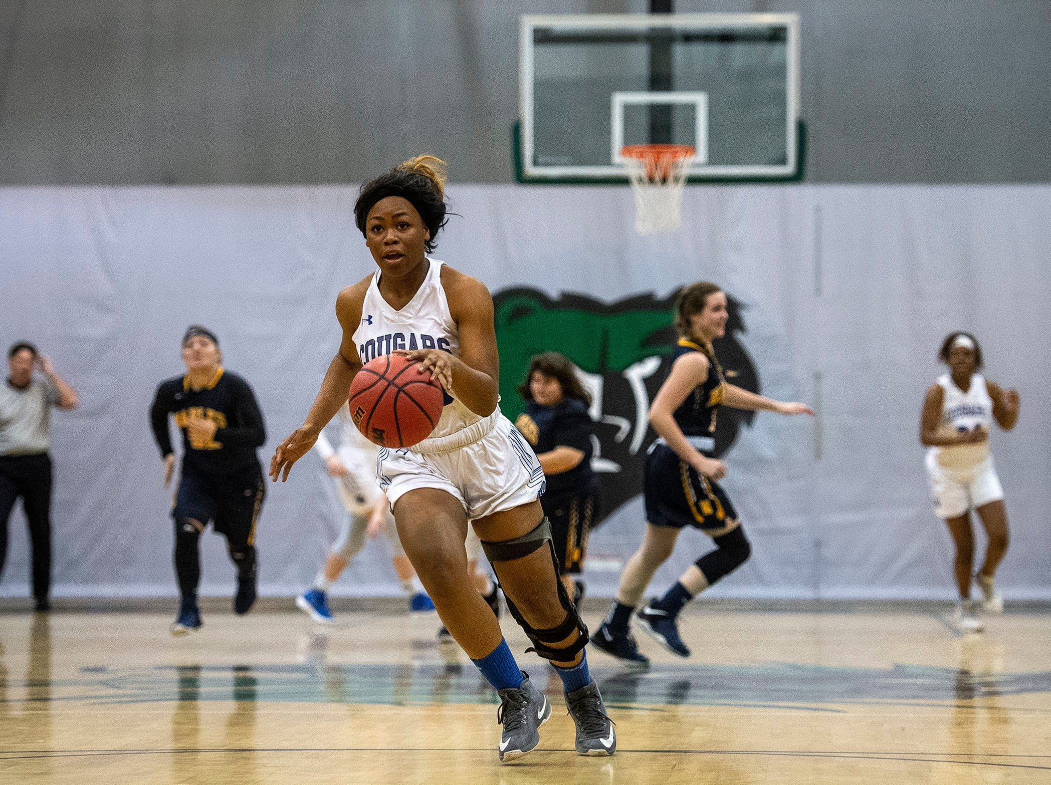 Barron Collier's Jada Mccray takes the ball down court during the Class 7A-District 12 Championship against Naples High School in Naples, Fla., on Friday, Feb. 8, 2019.