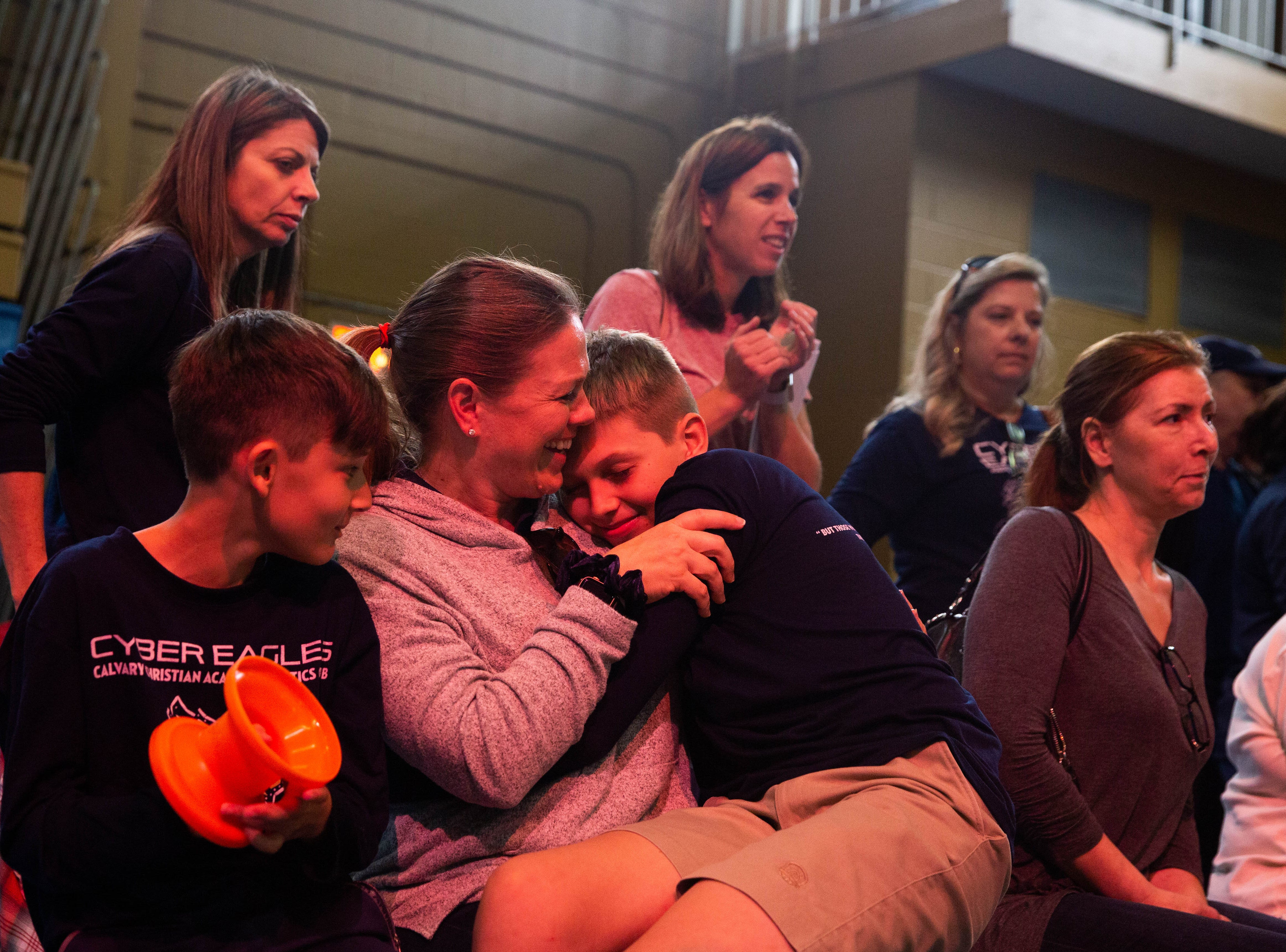 Debra D'Astino hugs her son Dylan D'Astino, who is part of the Calvary Christian Academy Cyber Eagles, at the VEX Robotics tournament at the Community School of Naples on February 9, 2019. The team drove from Fort Lauderdale to compete with over 25 teams.