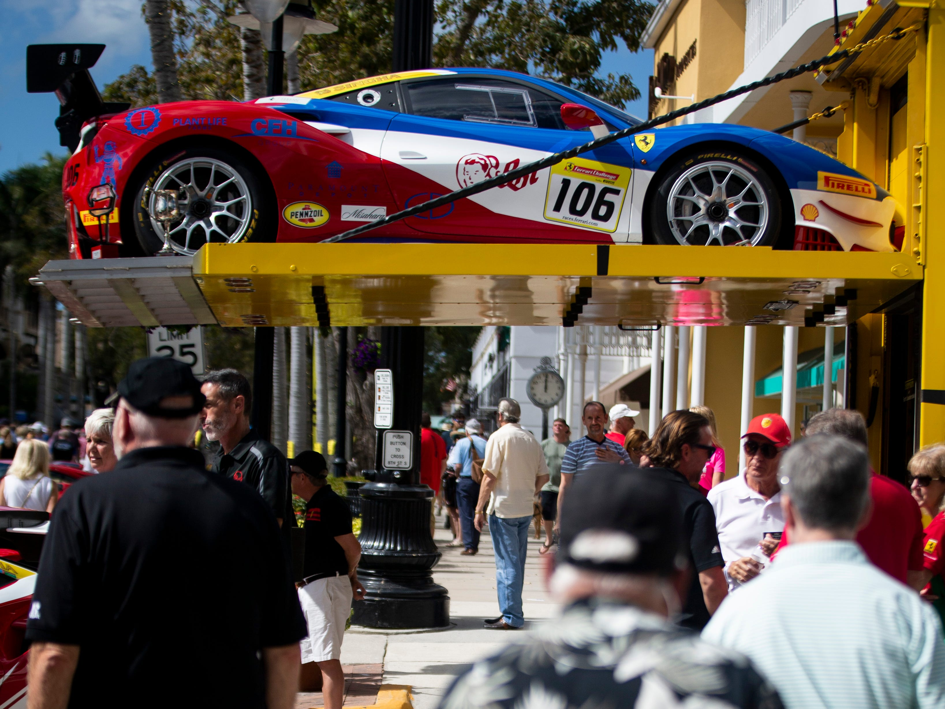A Ferrari Challenge sits above the crowd during the 15th annual Cars on 5th event, organized by the Naples Chapter of the Ferrari Club of America, on 5th Avenue South in Naples, on Saturday, February 9, 2019. Proceeds from the event go to St. MatthewÕs House, which helps people who are homeless, hungry, or recovering from substance abuse.