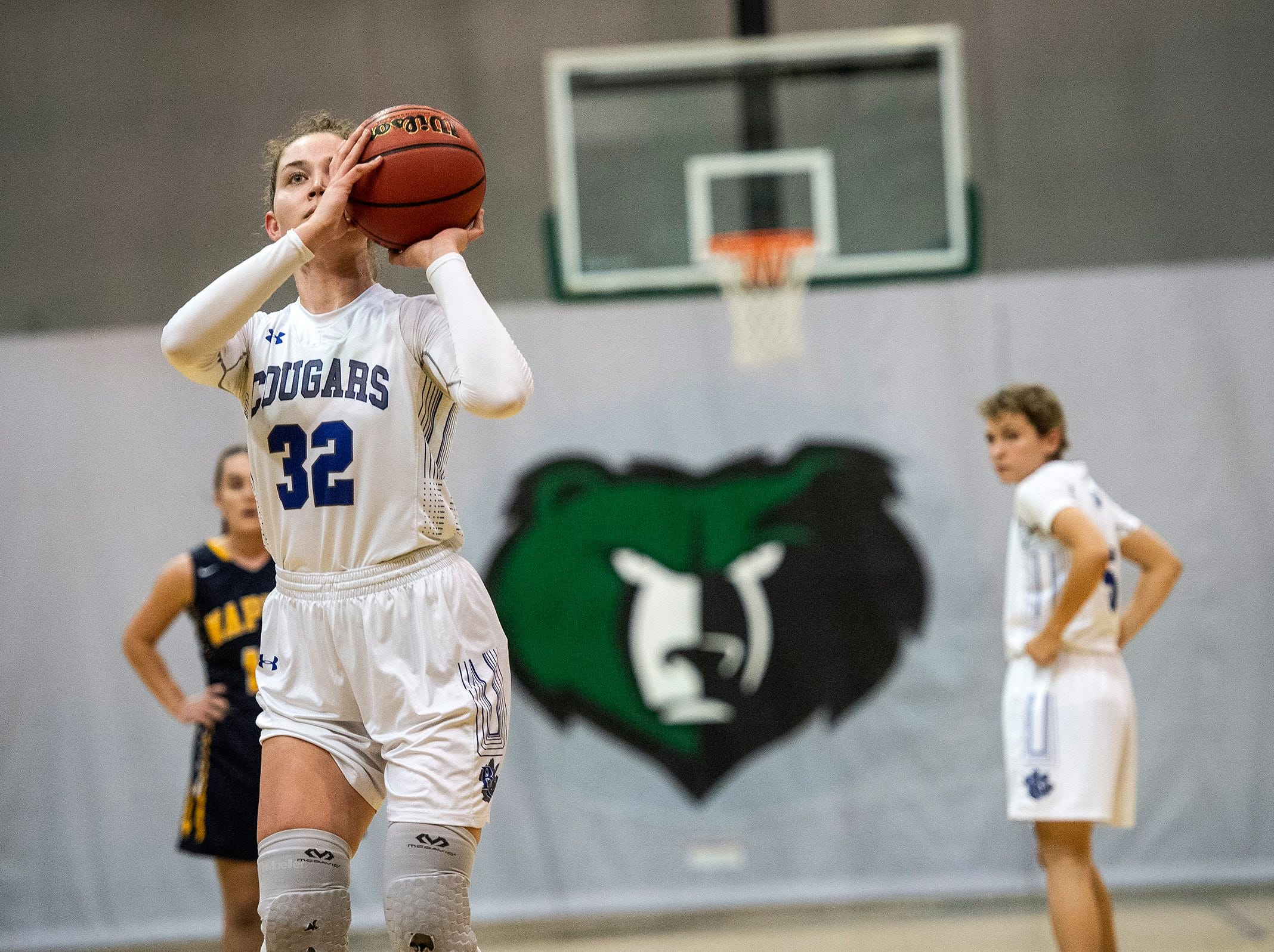 Barron Collier's Halie Egan lines up a free throw during the Class 7A-District 12 Championship against Naples High School in Naples, Fla., on Friday, Feb. 8, 2019.