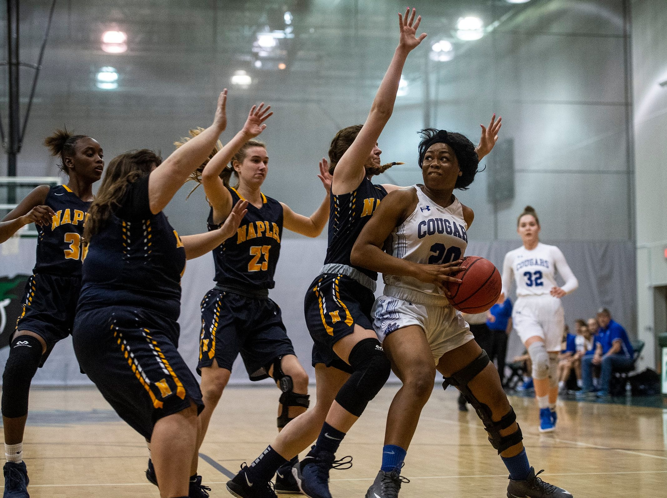 Barron Collier's Jada Mccray tries to get past defense during the Class 7A-District 12 Championship against Naples High School in Naples, Fla., on Friday, Feb. 8, 2019.