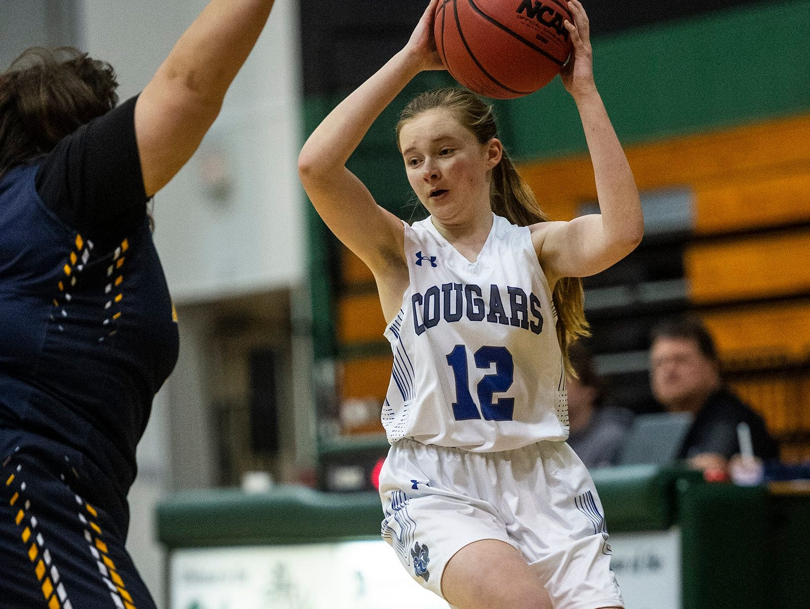 Barron Collier's Cierra Alderman looks to pass during the Class 7A-District 12 Championship against Naples High School in Naples, Fla., on Friday, Feb. 8, 2019.