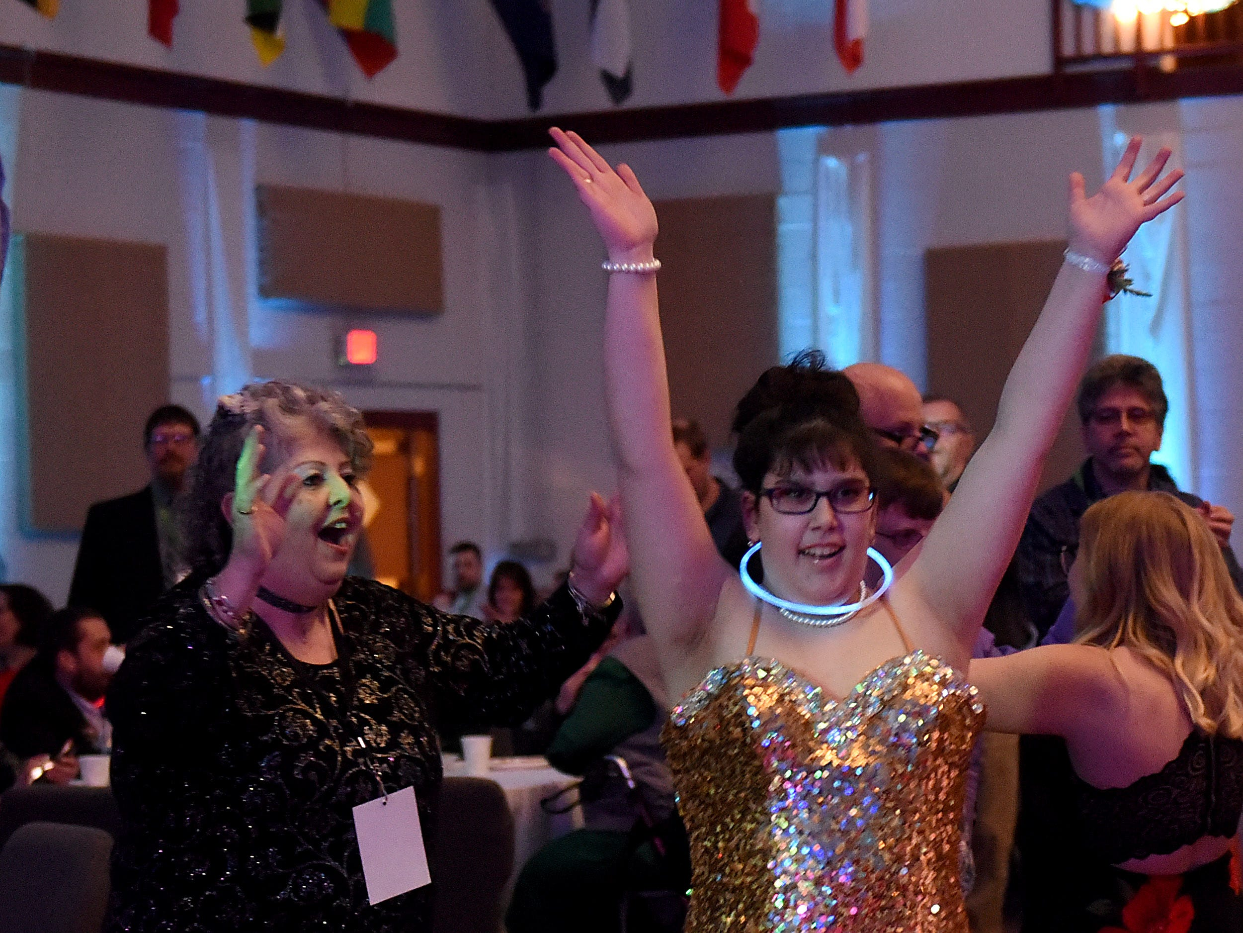 "Debra Carson and Samantha Madden dance to the ""YMCA"" during the annual Night to Shine dance, sponsored by the Tim Tebow Foundation, on Friday, Feb. 8, 2019 at Community Church in Newark. Churches around the world hosted prom night experiences for guests with special needs. Over 200 guests with special needs enjoyed dinner, hair and makeup, karaoke, and a night of dancing. 655 churches around the world hosted similar events on Friday according to the Tim Tebow Foundation."