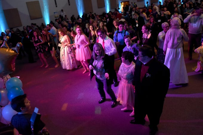 "Guests do the ""Cupid Shuffle"" during the annual Night to Shine dance, sponsored by the Tim Tebow Foundation, on Friday, Feb. 8, 2019 at Community Church in Newark. Churches around the world hosted prom night experiences for guests with special needs. Over 200 guests with special needs enjoyed dinner, hair and makeup, karaoke, and a night of dancing. 655 churches around the world hosted similar events on Friday according to the Tim Tebow Foundation."