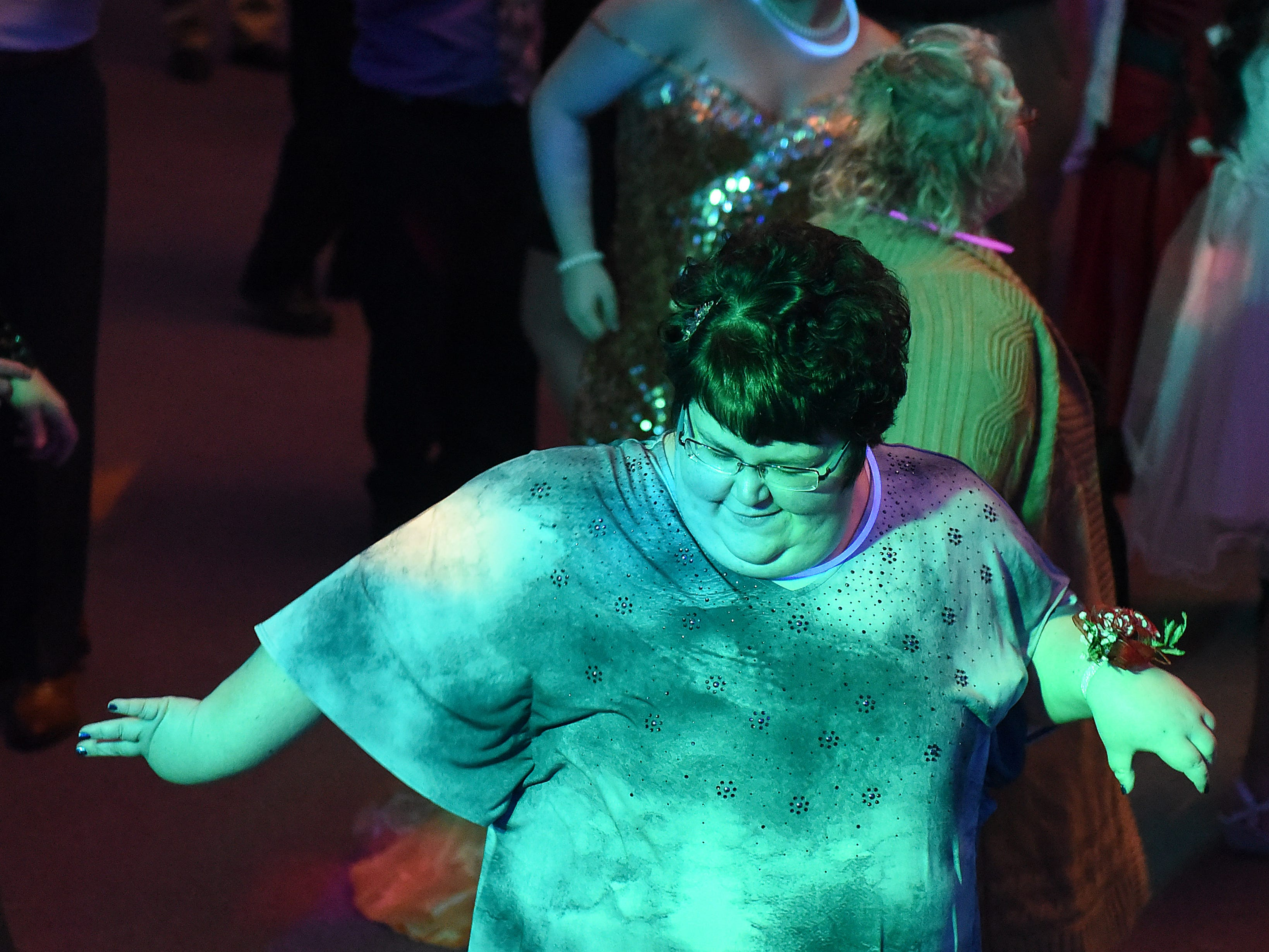 Halle Cough dances with other guests during the annual Night to Shine dance, sponsored by the Tim Tebow Foundation, on Friday, Feb. 8, 2019 at Community Church in Newark. Churches around the world hosted prom night experiences for guests with special needs. Over 200 guests with special needs enjoyed dinner, hair and makeup, karaoke, and a night of dancing. 655 churches around the world hosted similar events on Friday according to the Tim Tebow Foundation.
